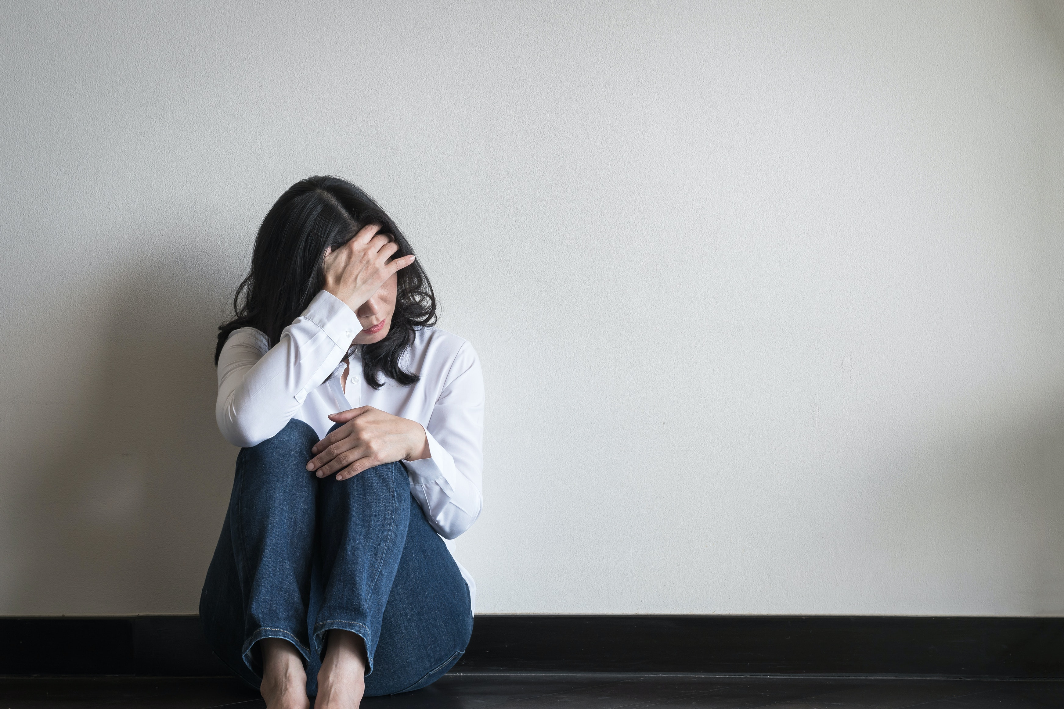 An image depicting a person suffering from anxiety due to certain triggers symptoms