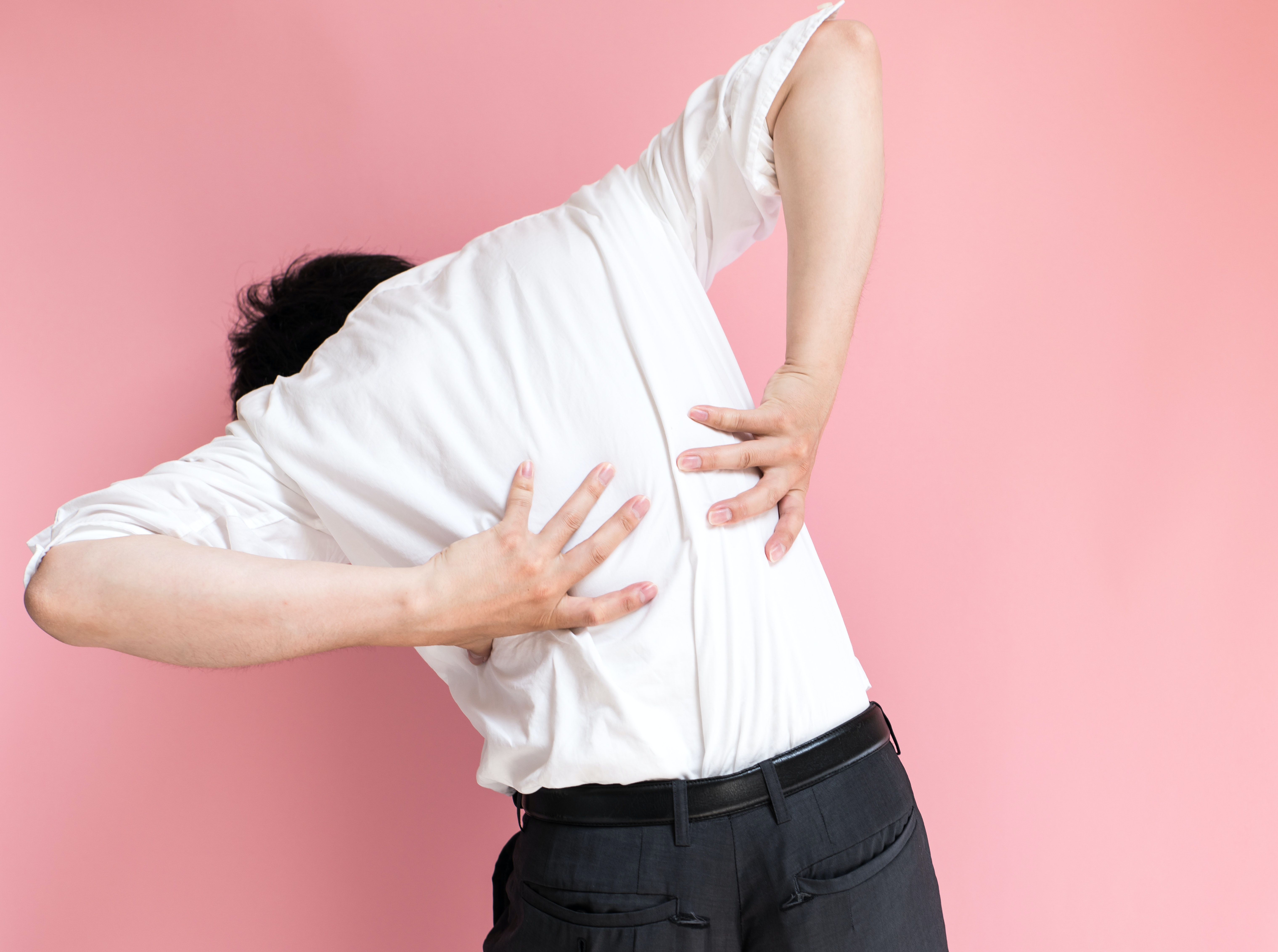 An image depicting a person suffering from back pain affecting the spine symptoms