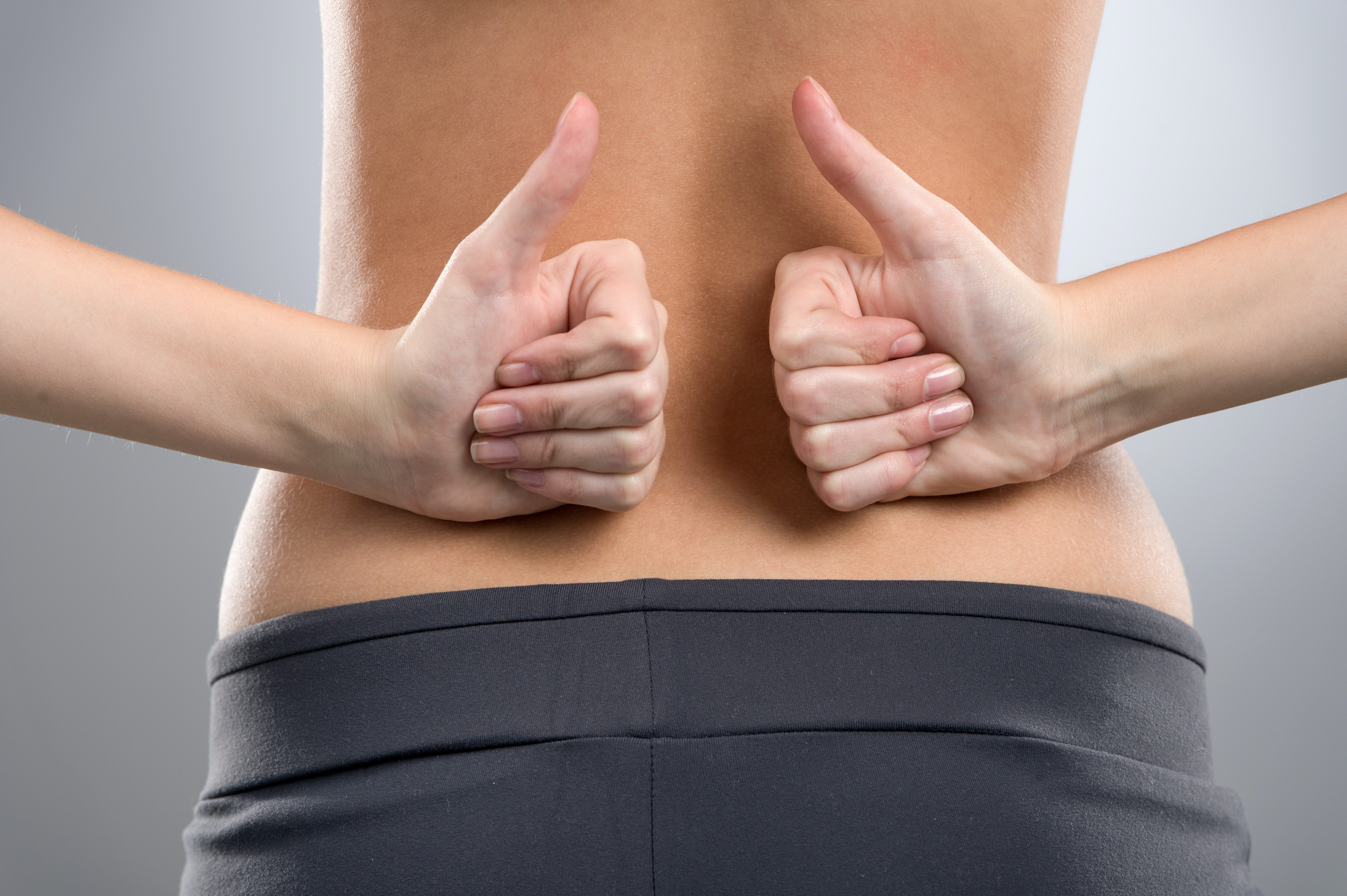 An image depicting a person suffering from back pain that shoots to the butt symptoms