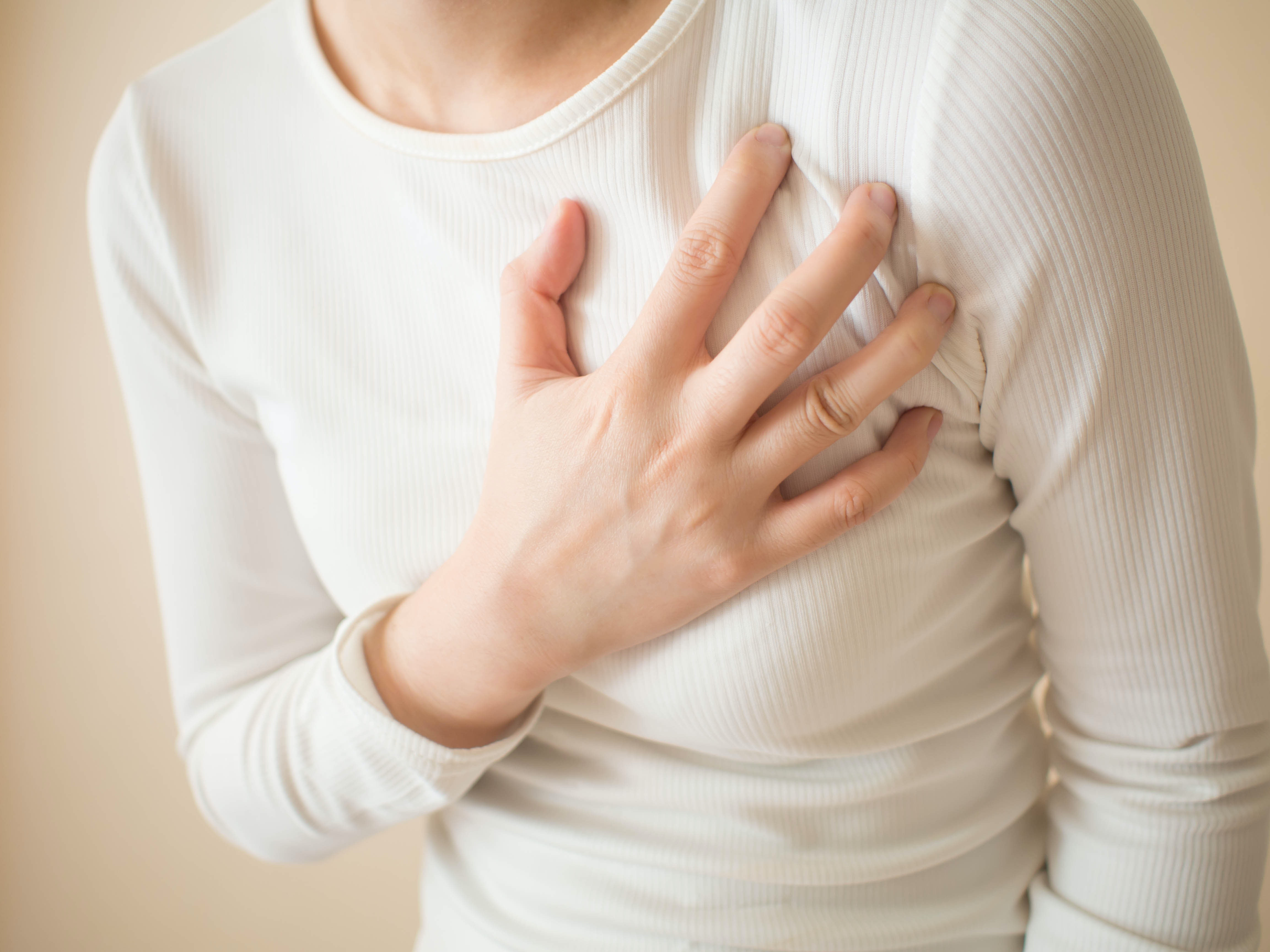 An image depicting a person suffering from breast pain symptoms