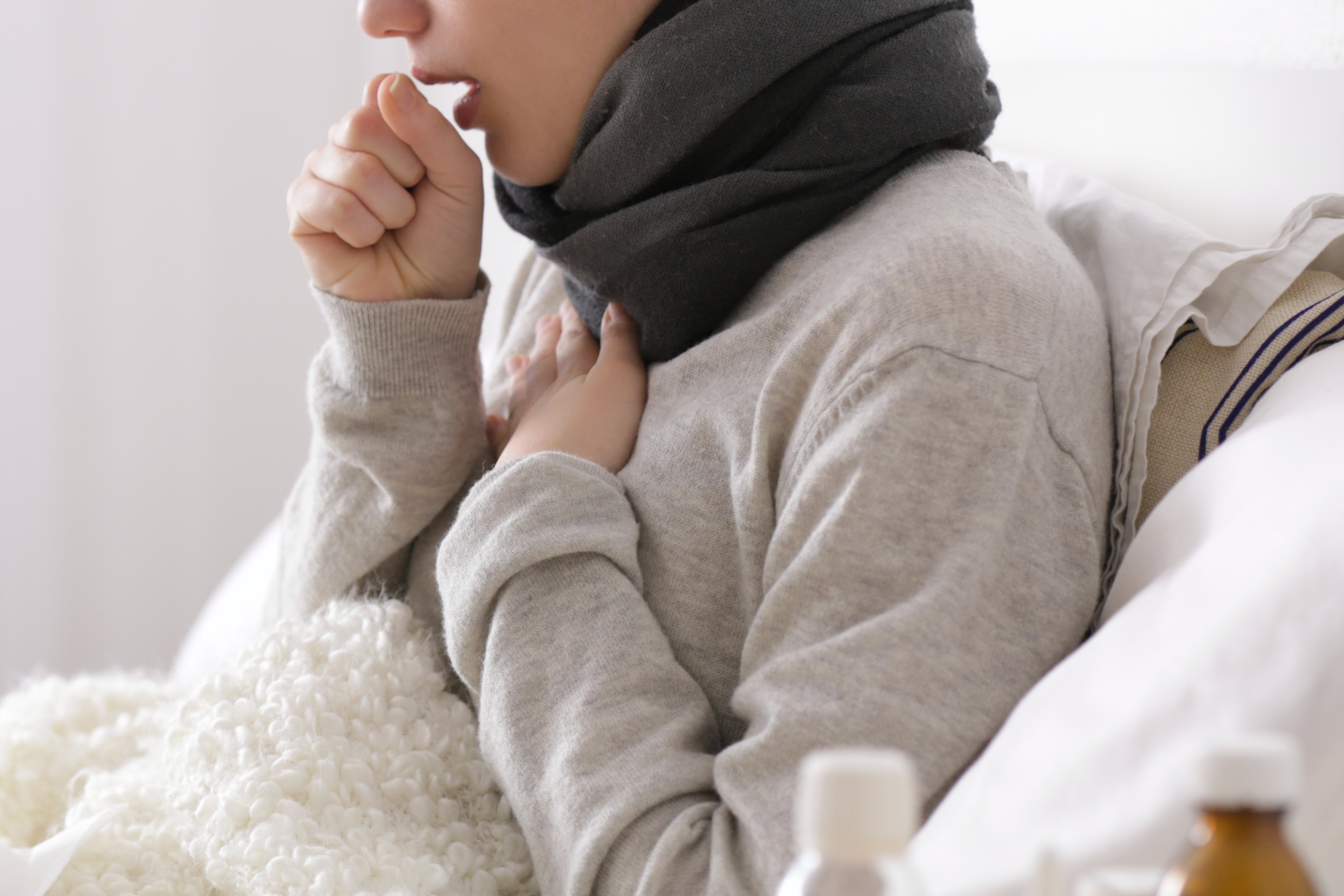 An image depicting a person suffering from Bronchitis symptoms