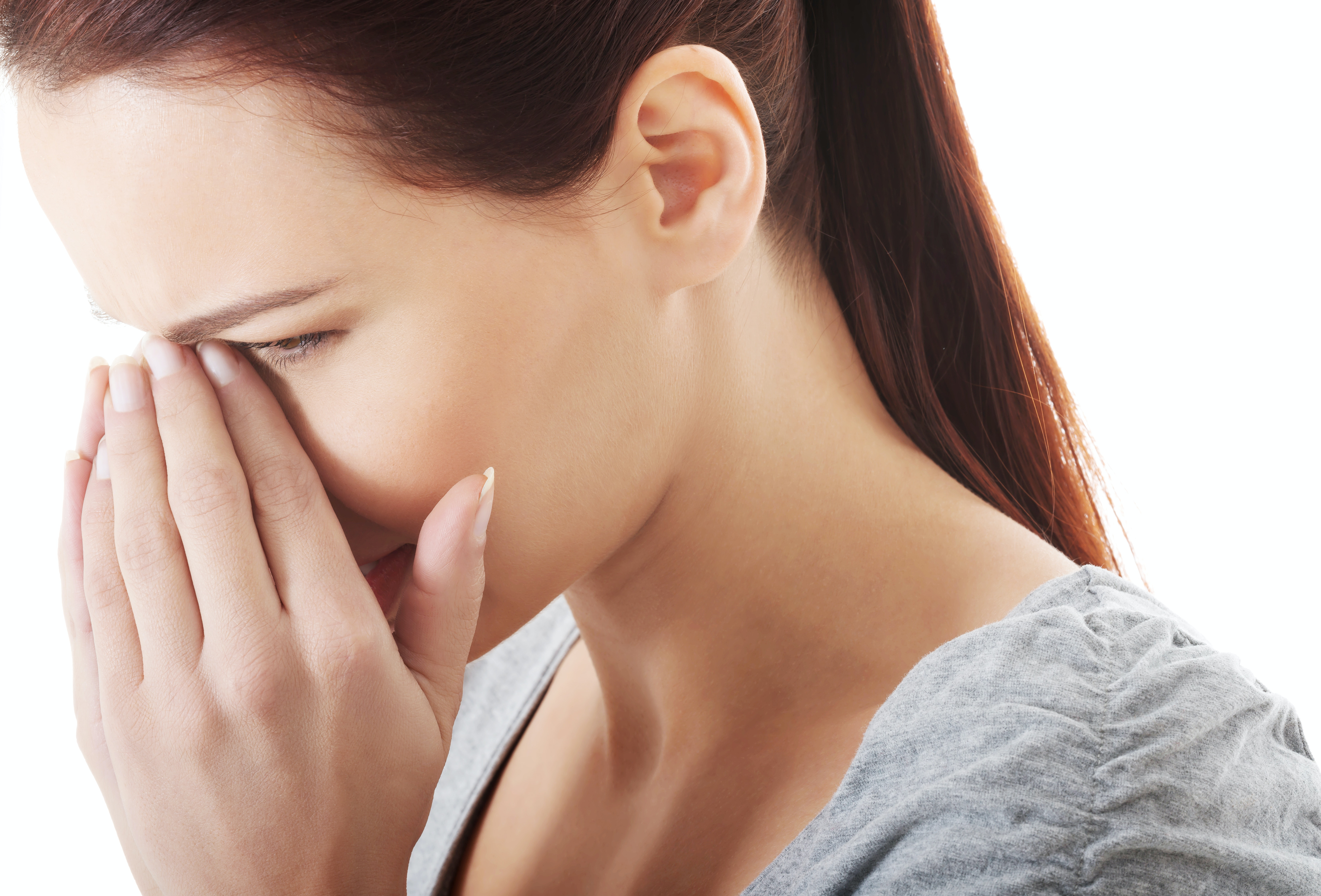 An image depicting a person suffering from bump in or on the nose symptoms