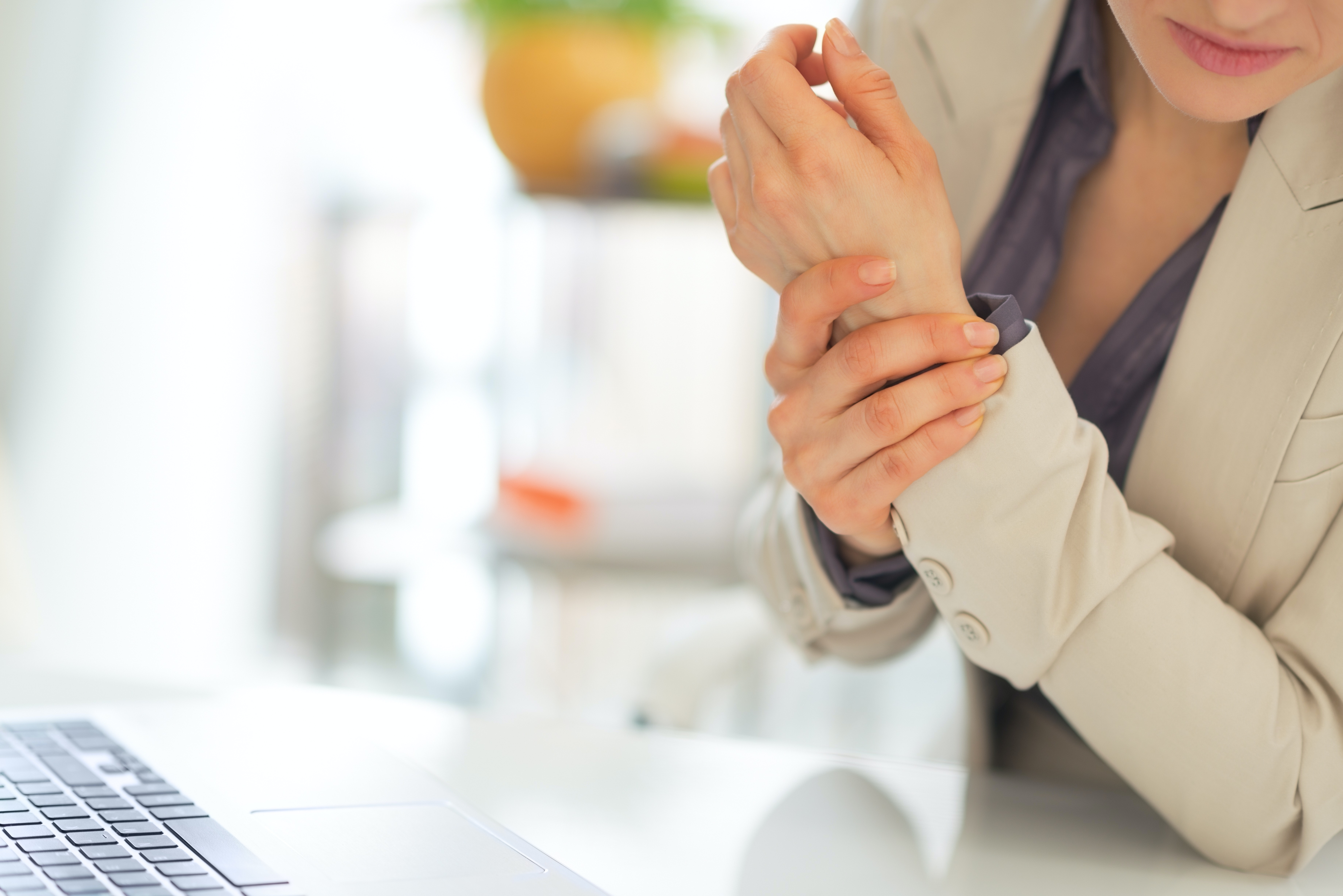 An image depicting a person suffering from Carpal Tunnel Syndrome symptoms