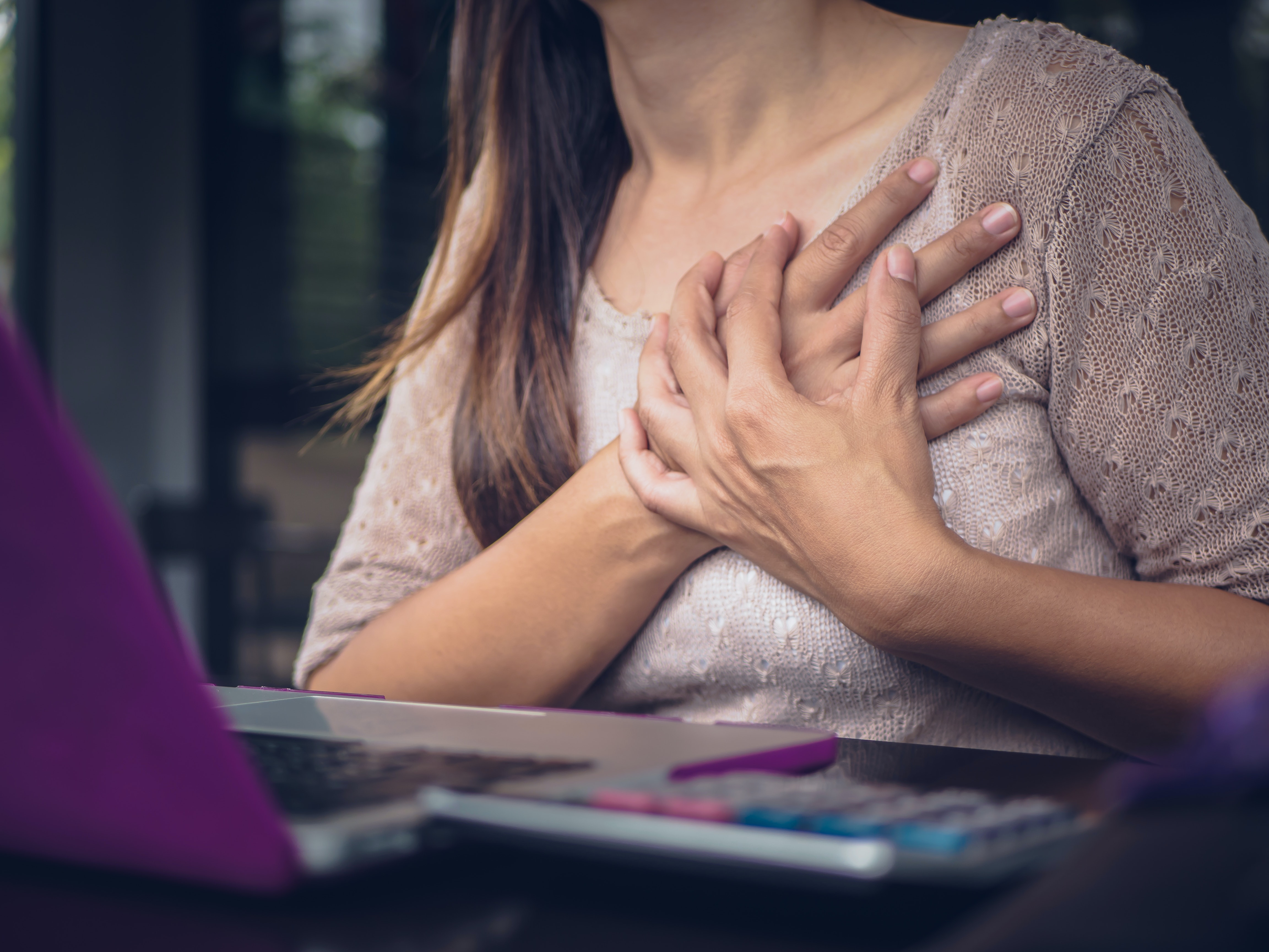 An image depicting a person suffering from chest pain symptoms