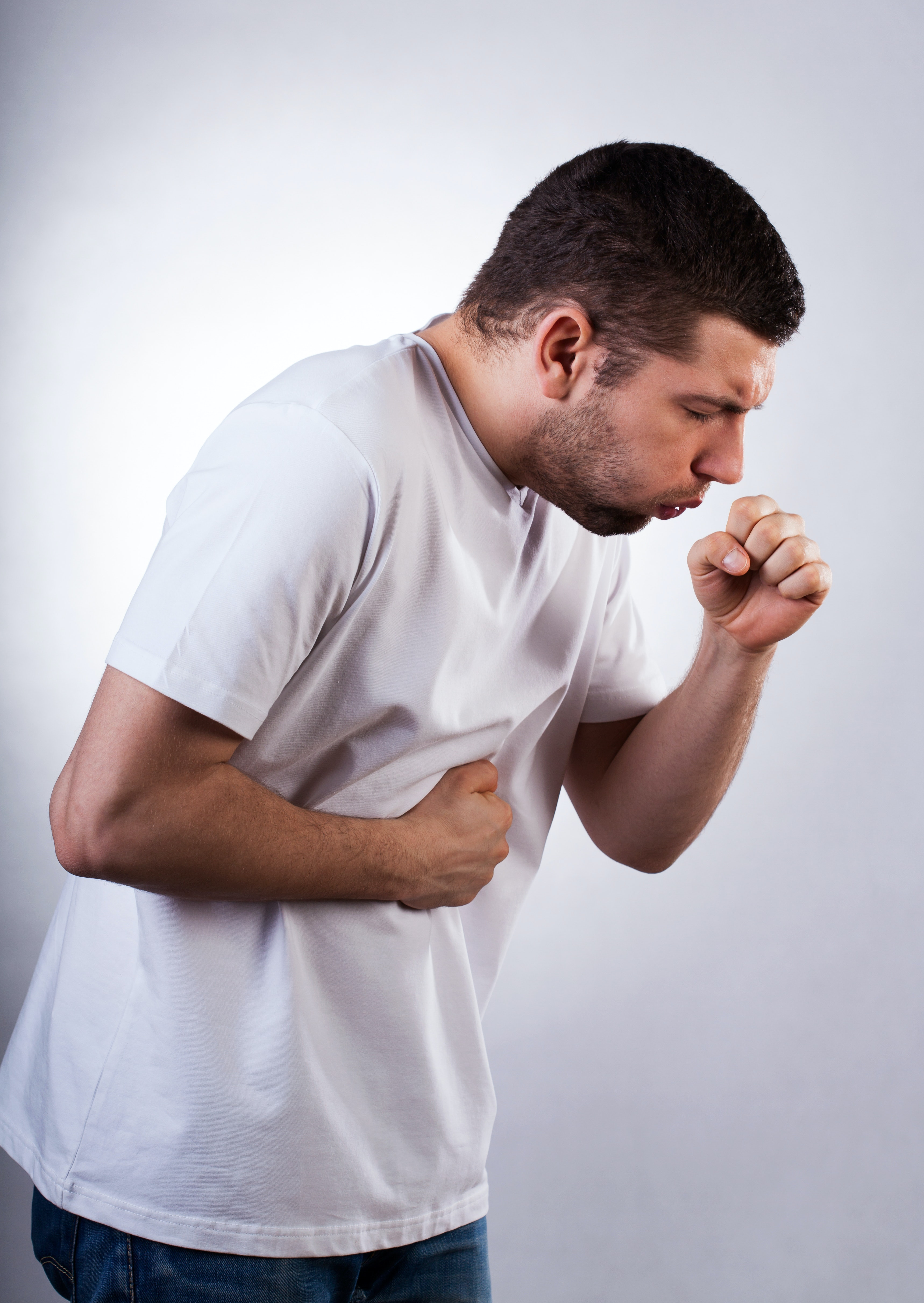 An image depicting a person suffering from coughing with a whooping sound symptoms