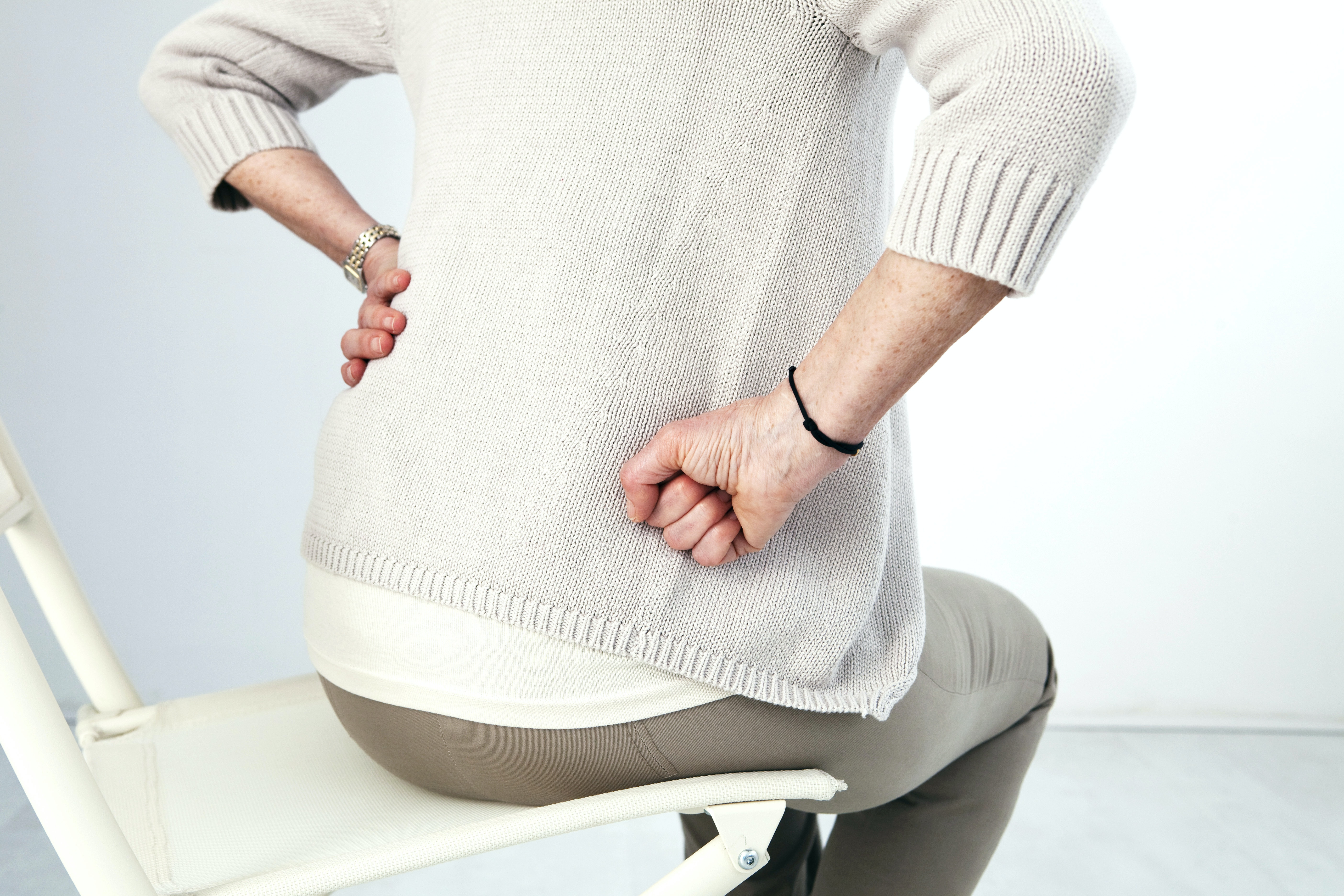 An image depicting a person suffering from Developmental Dysplasia of the Hip symptoms
