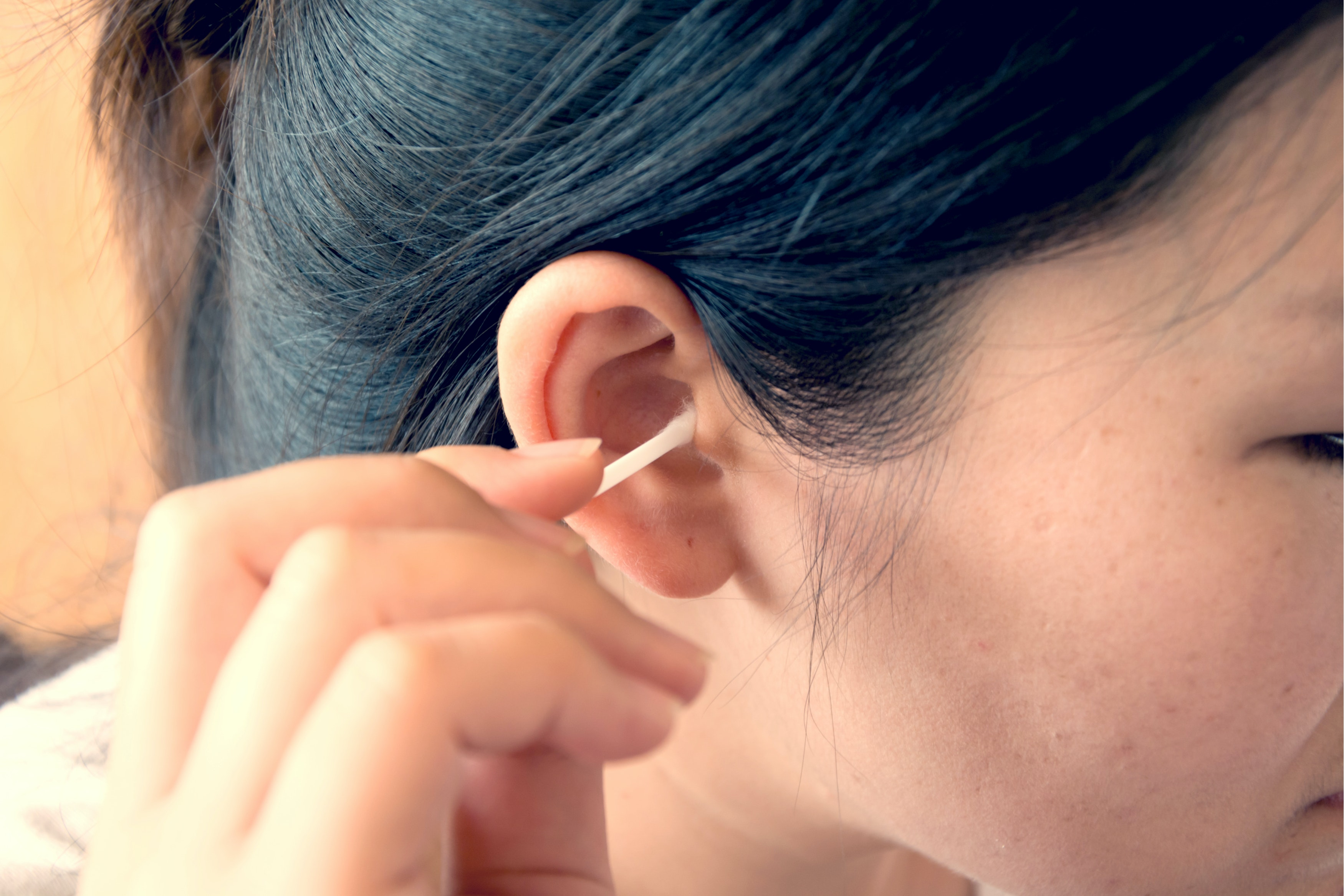 An image depicting a person suffering from ear discharge symptoms