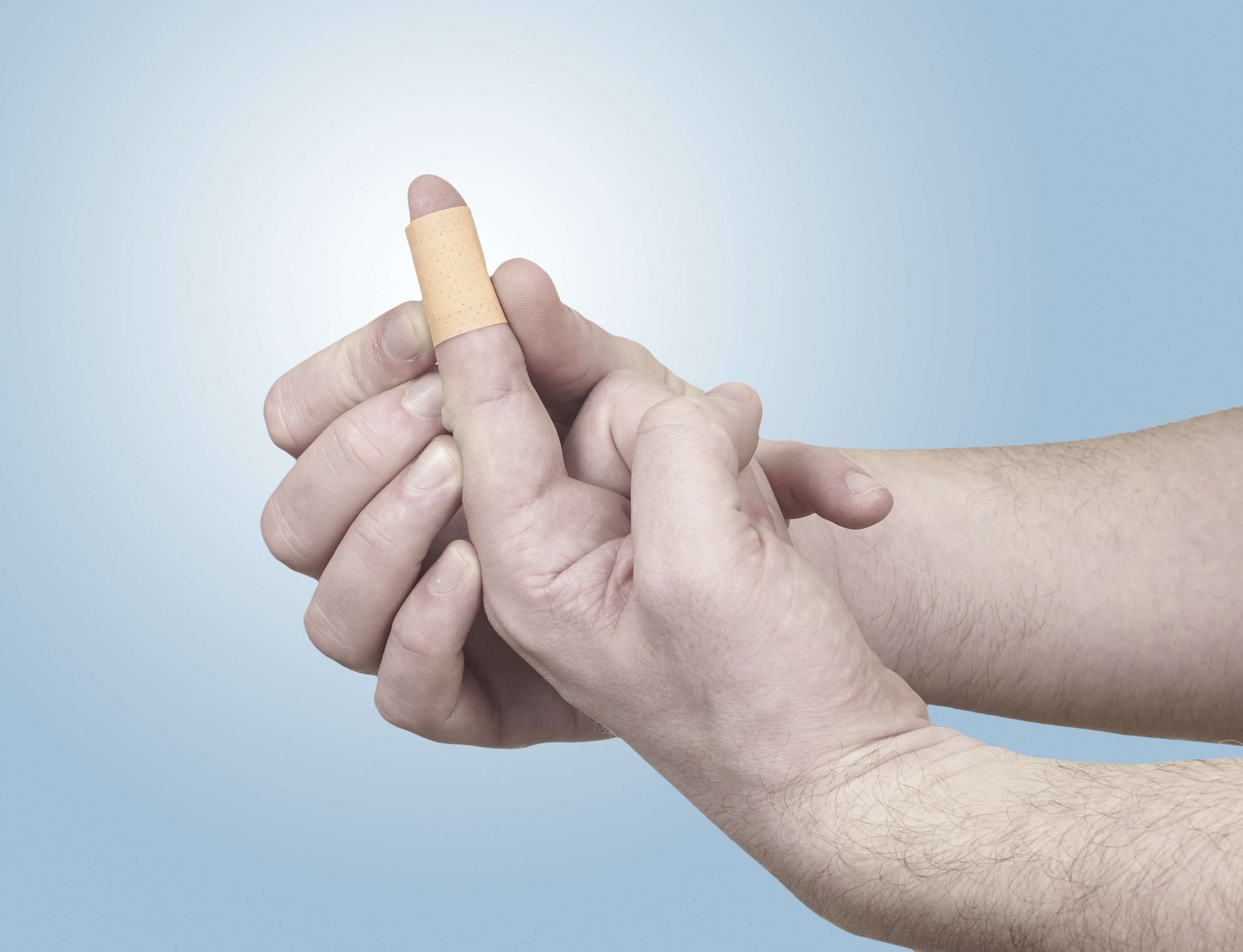 An image depicting a person suffering from finger pain symptoms