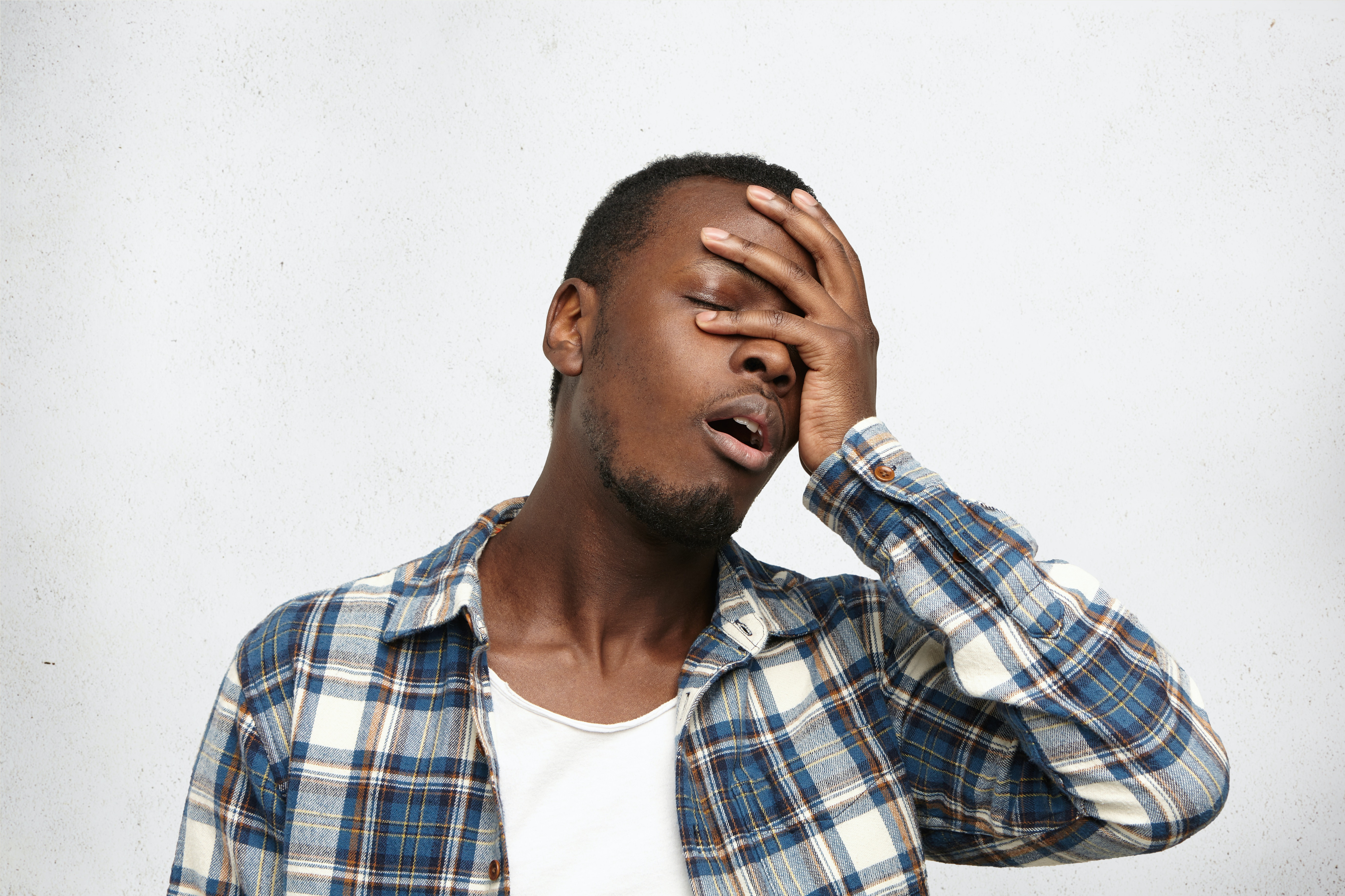 An image depicting a person suffering from forgetfulness symptoms