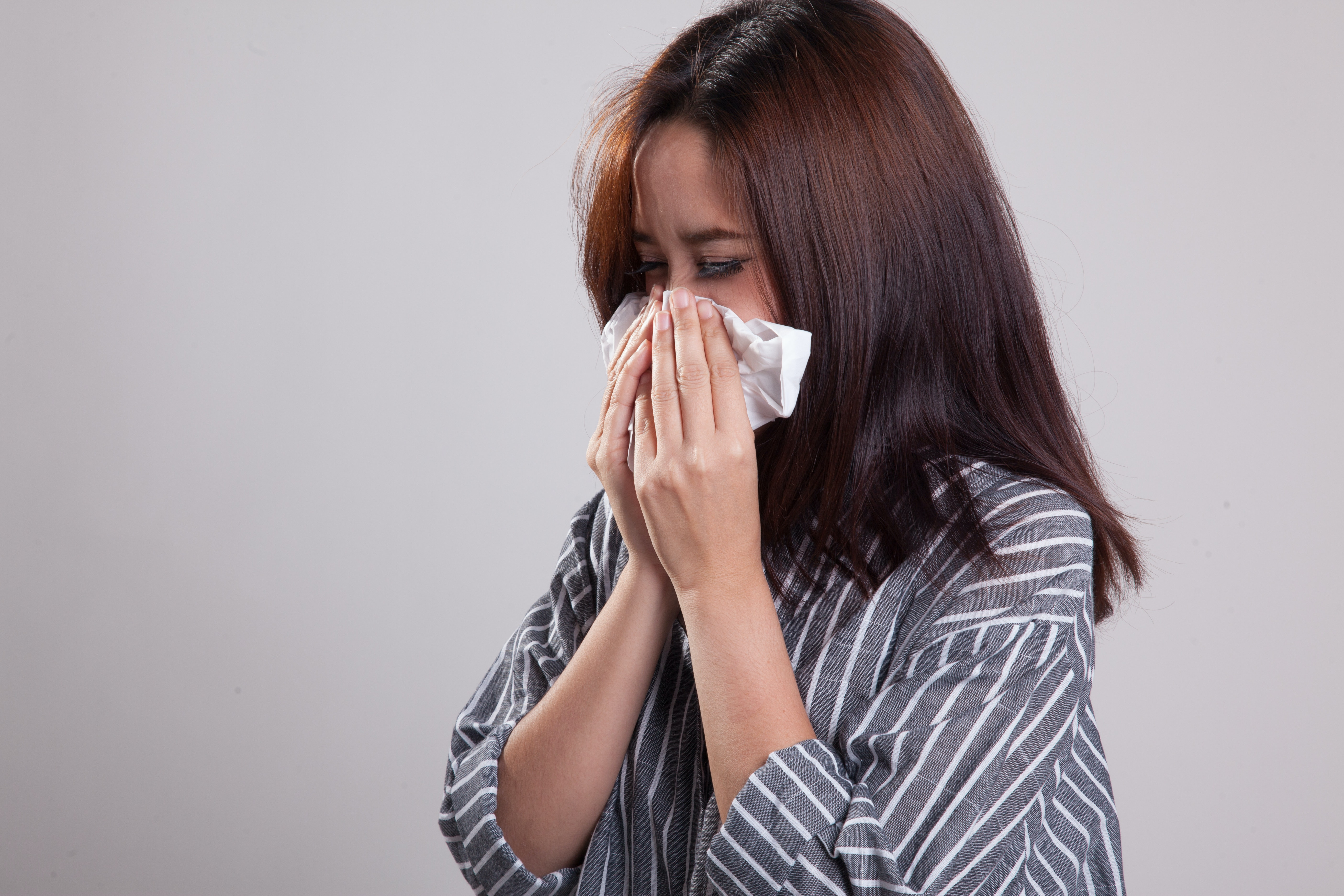 An image depicting a person suffering from frequent sneezing symptoms