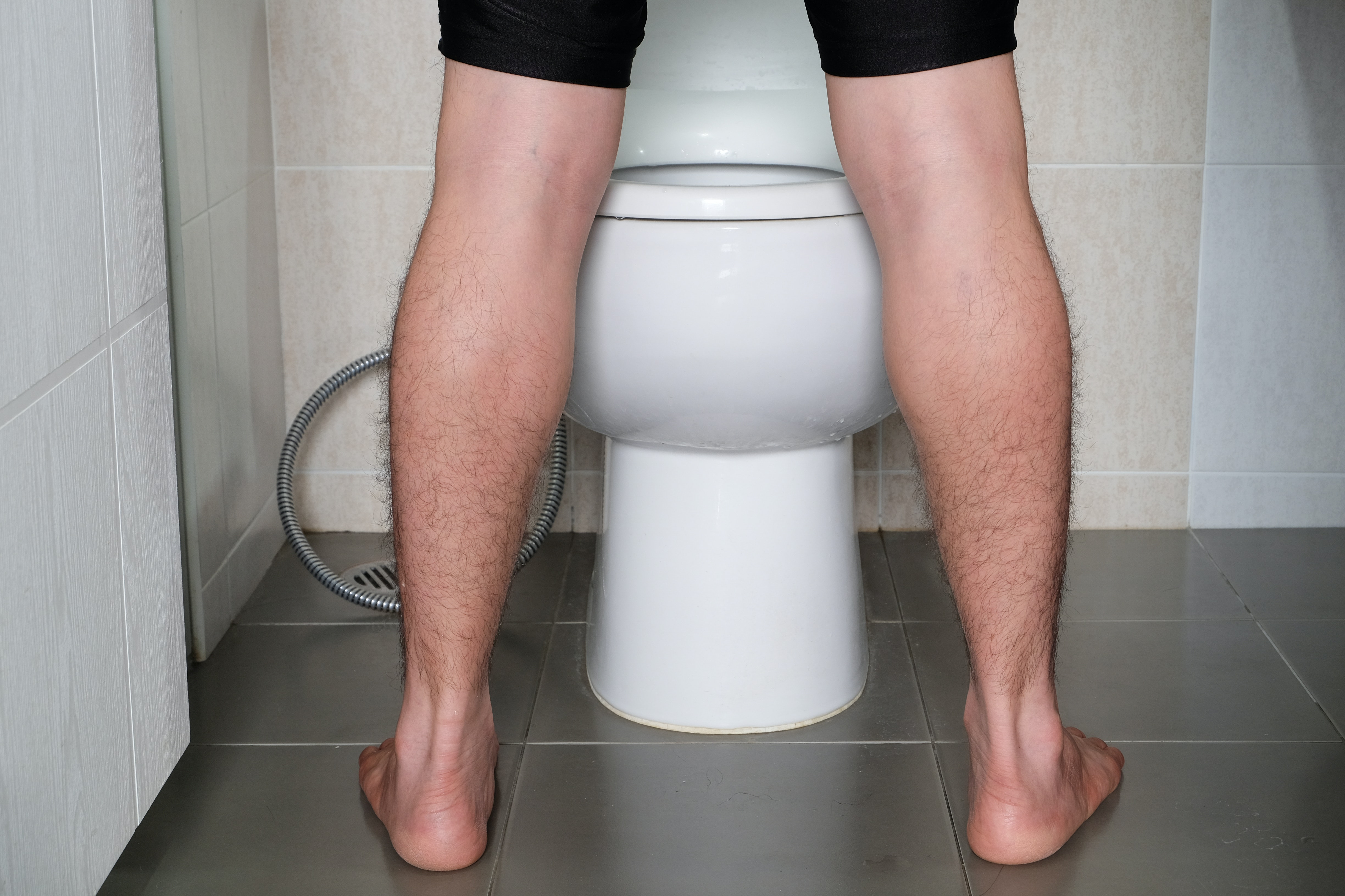 An image depicting a person suffering from frequent urination symptoms