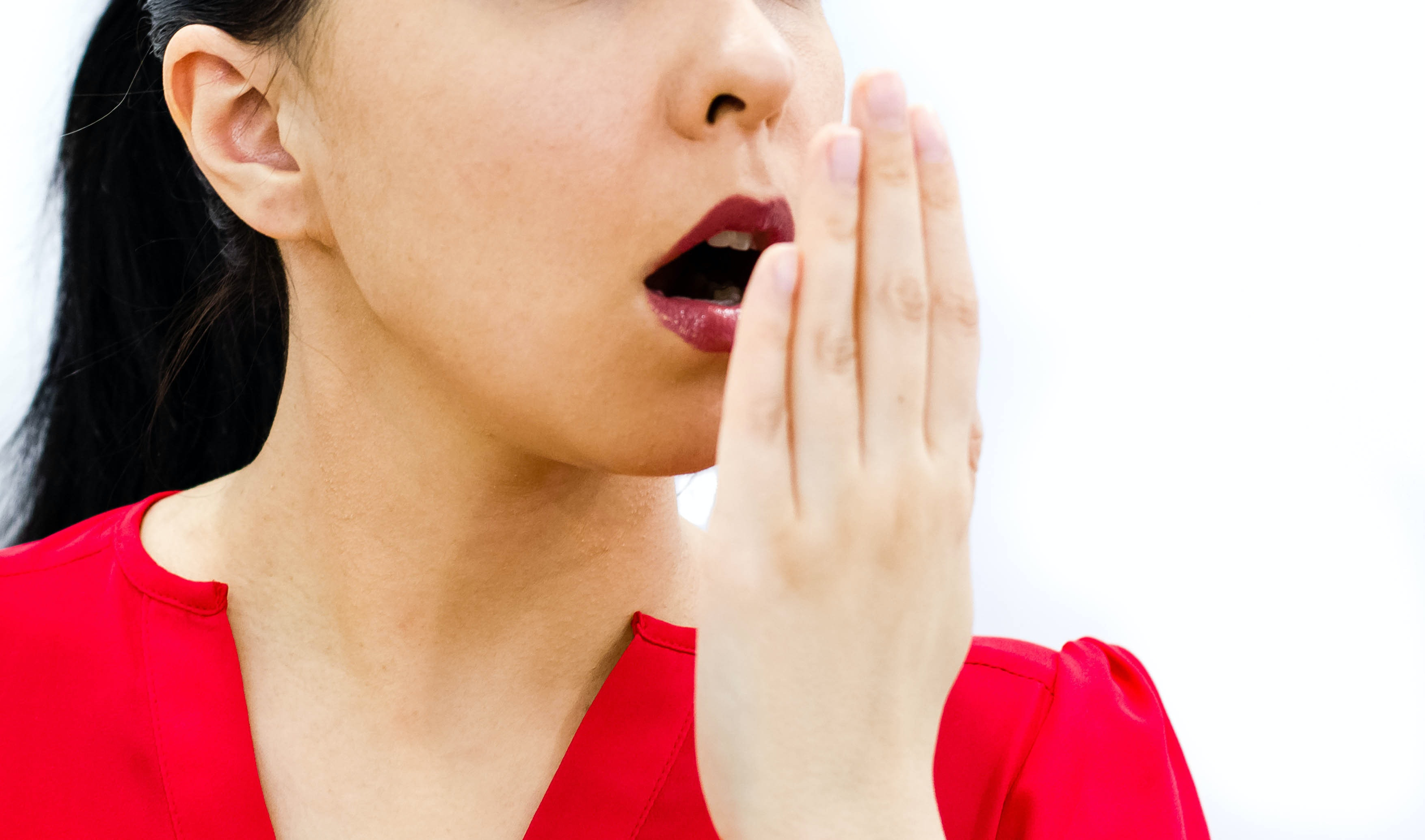 An image depicting a person suffering from fruity odor on breath symptoms