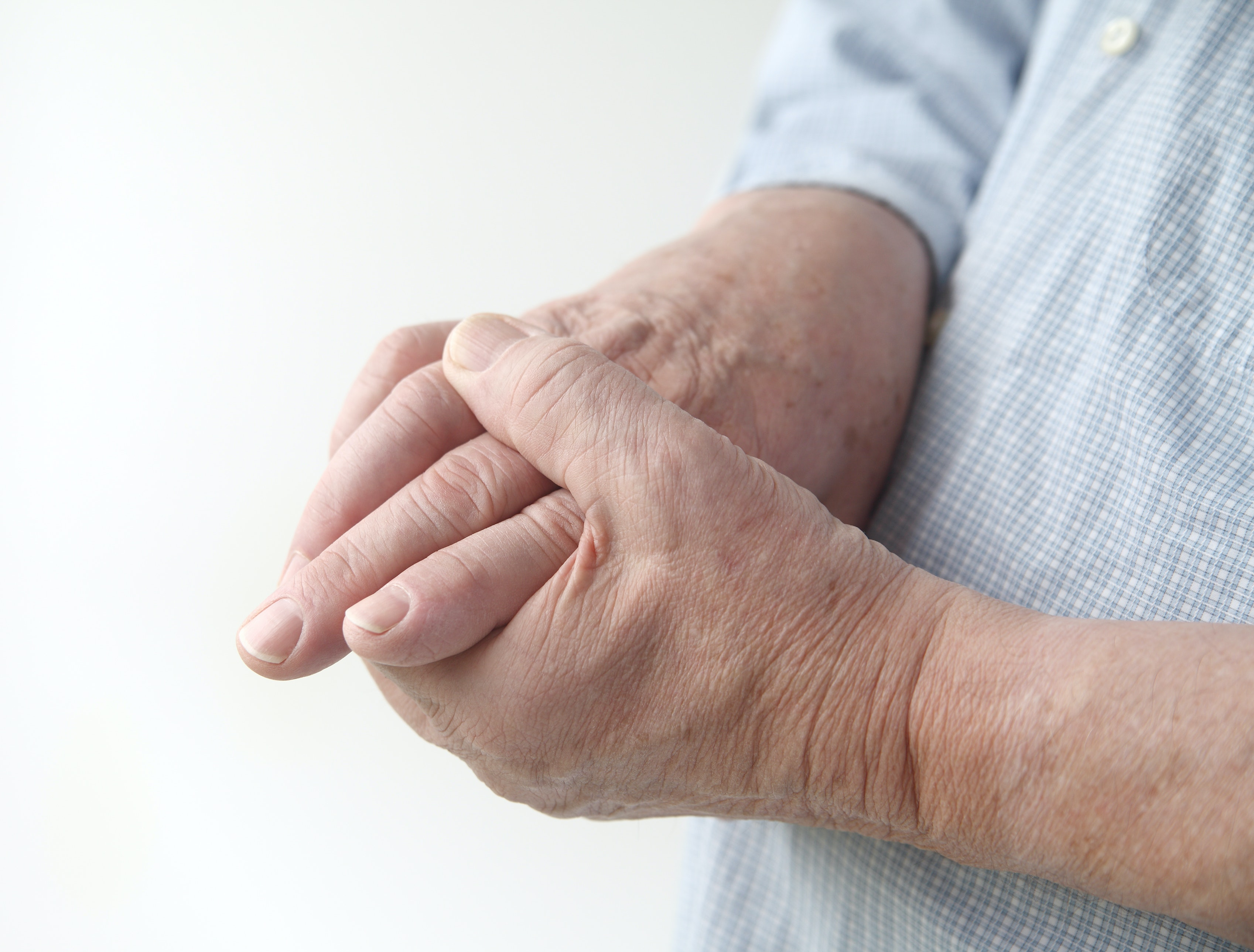 An image depicting a person suffering from hand tingling symptoms