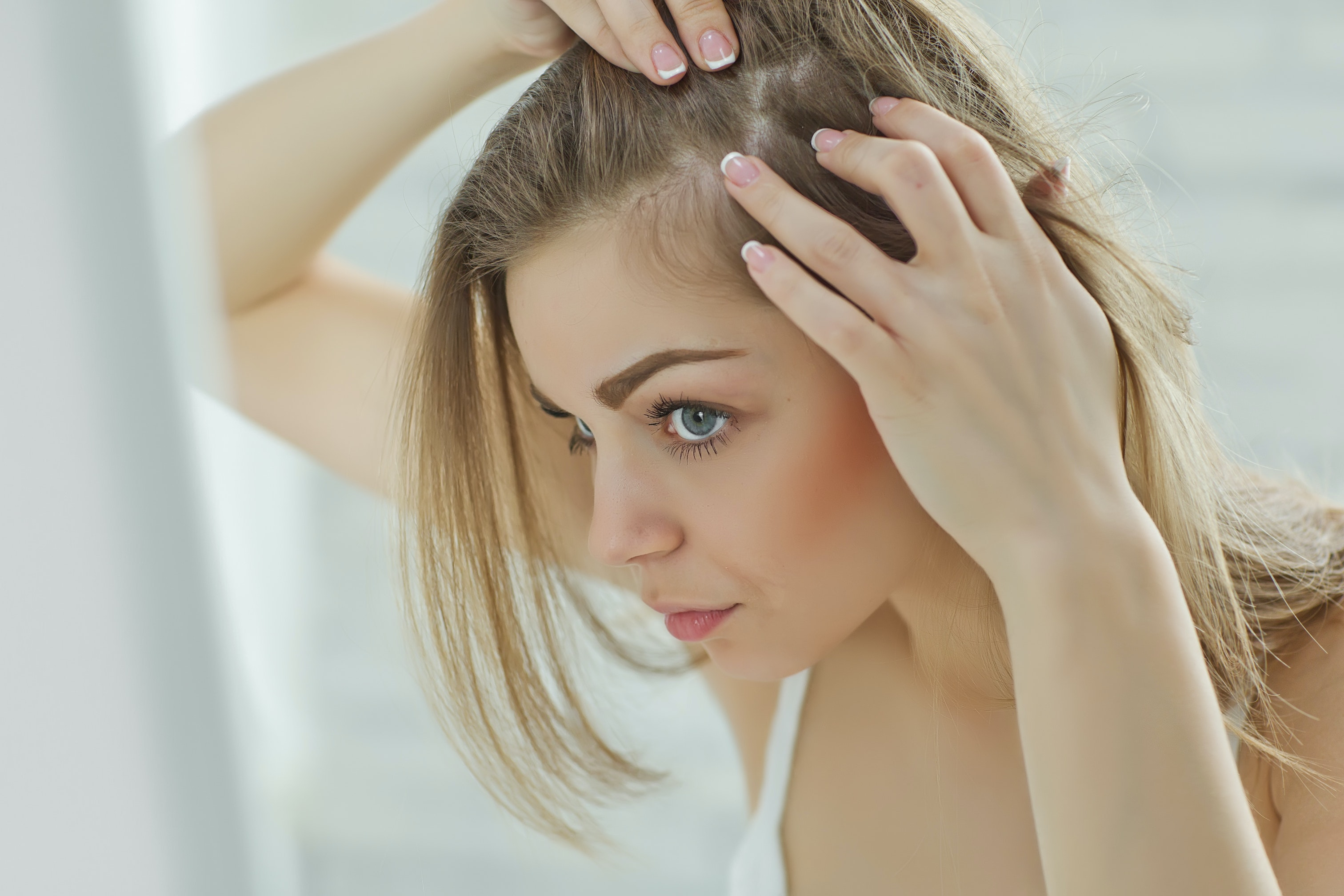 An image depicting a person suffering from hard scalp bump symptoms