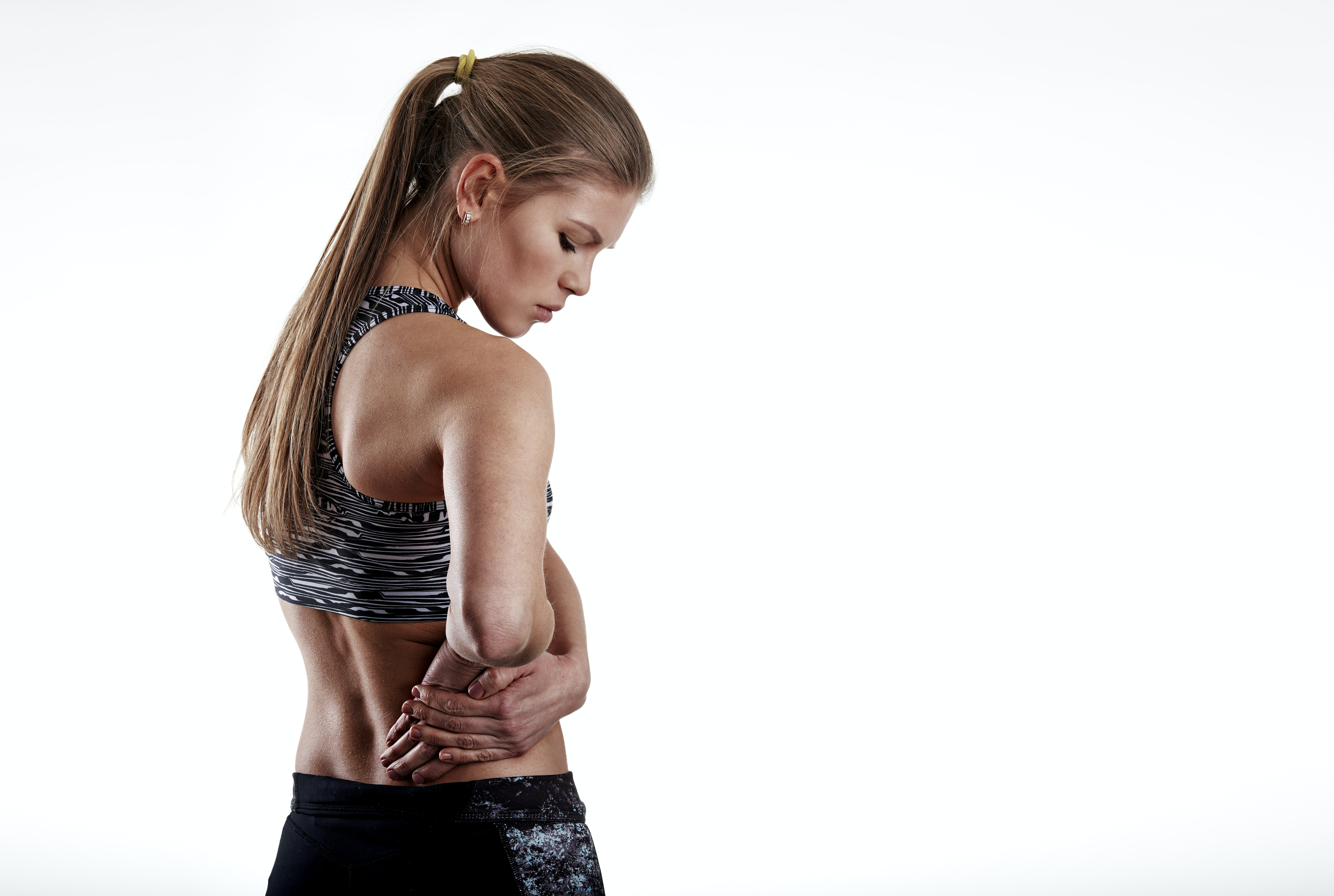 An image depicting a person suffering from hip pain from overuse symptoms