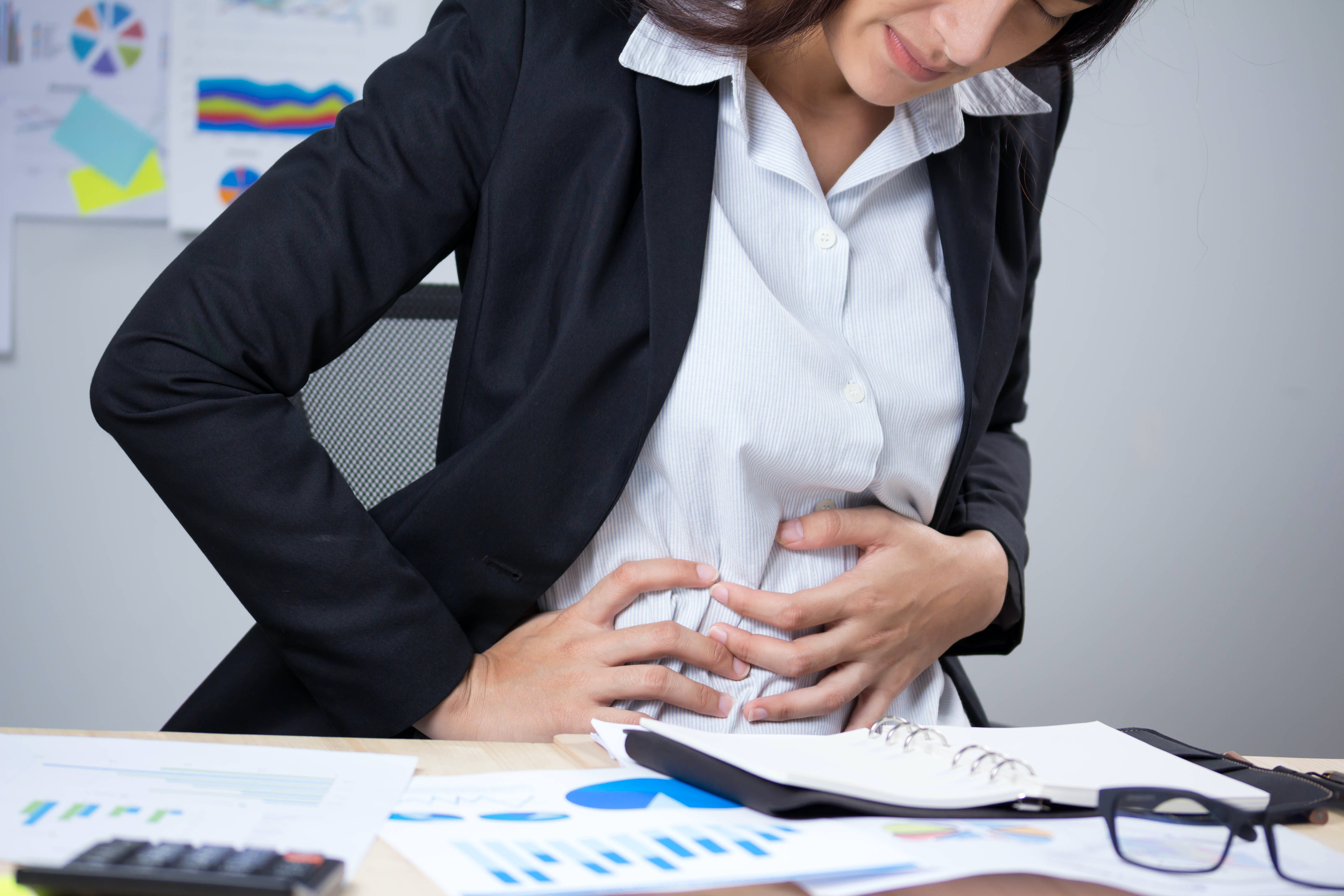 An image depicting a person suffering from Irritable Bowel Syndrome (IBS) symptoms