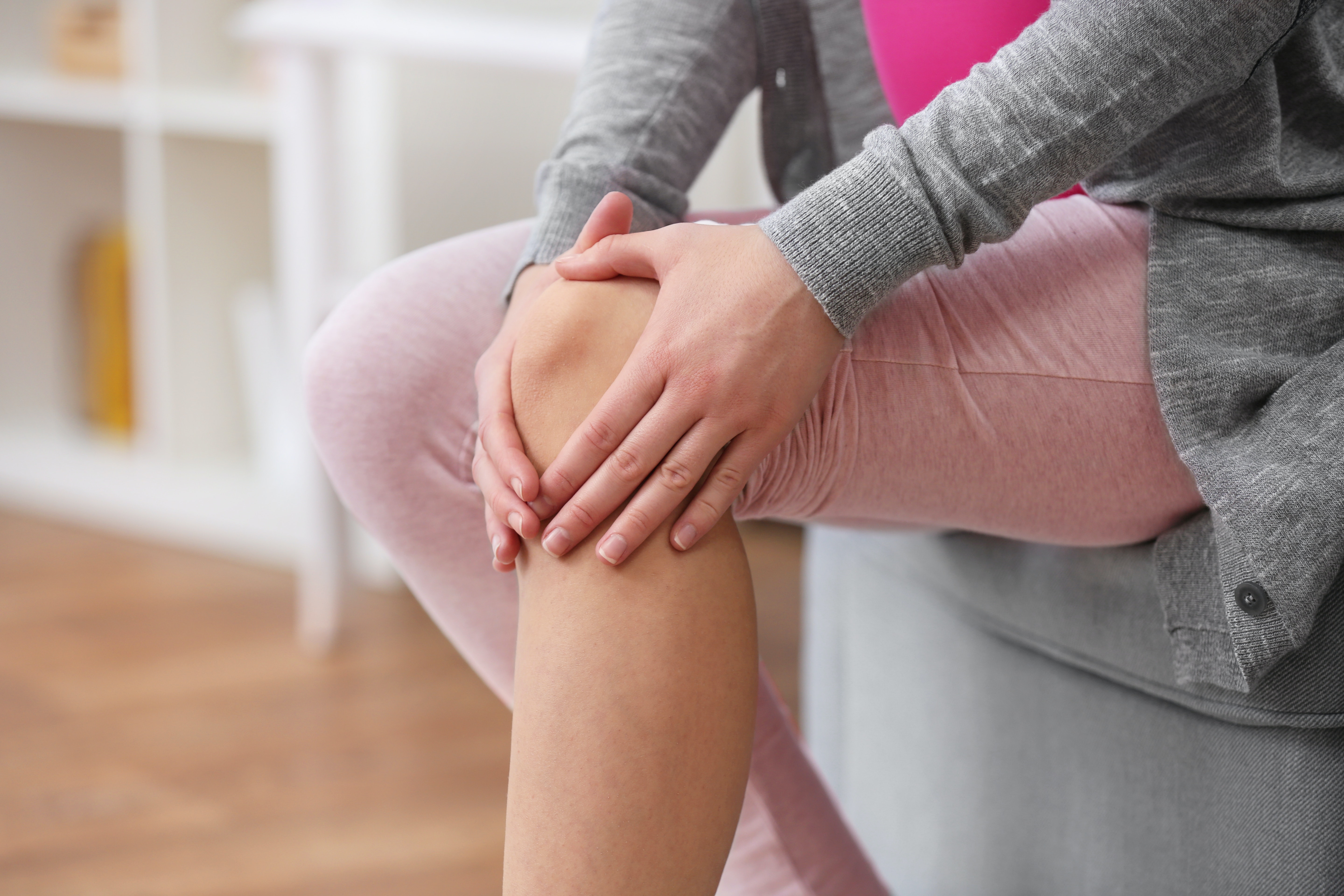 An image depicting a person suffering from joint pain symptoms