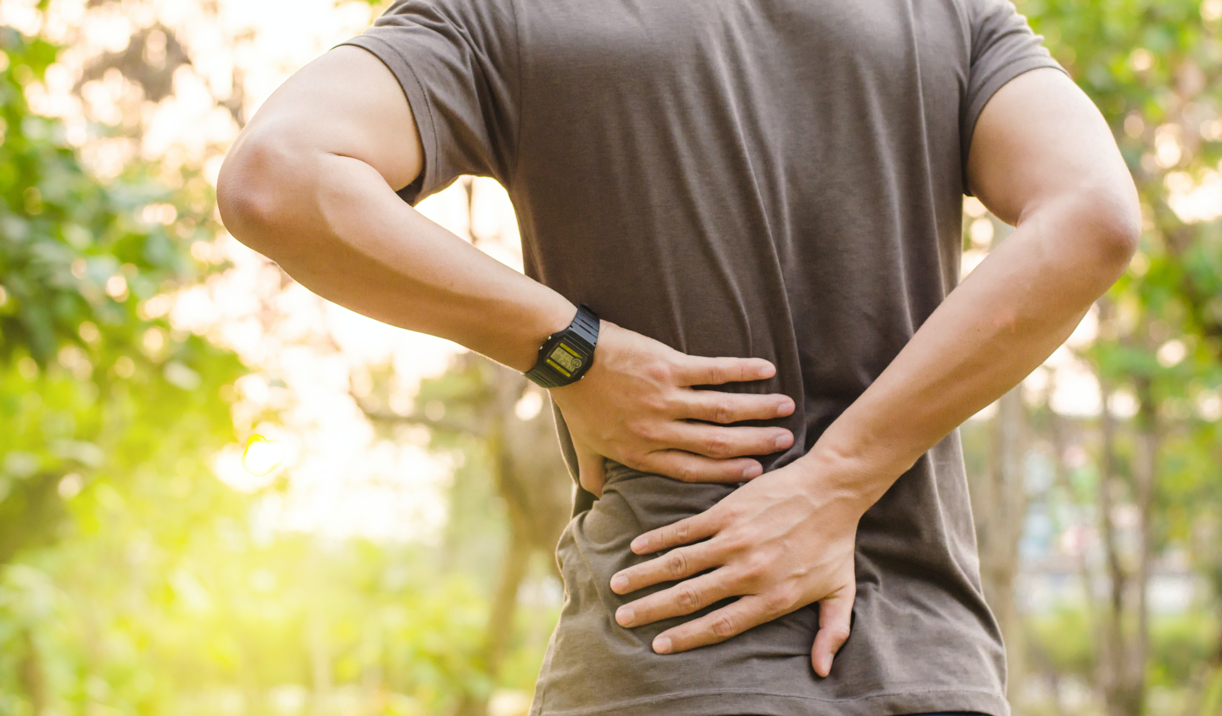 An image depicting a person suffering from lower back pain symptoms