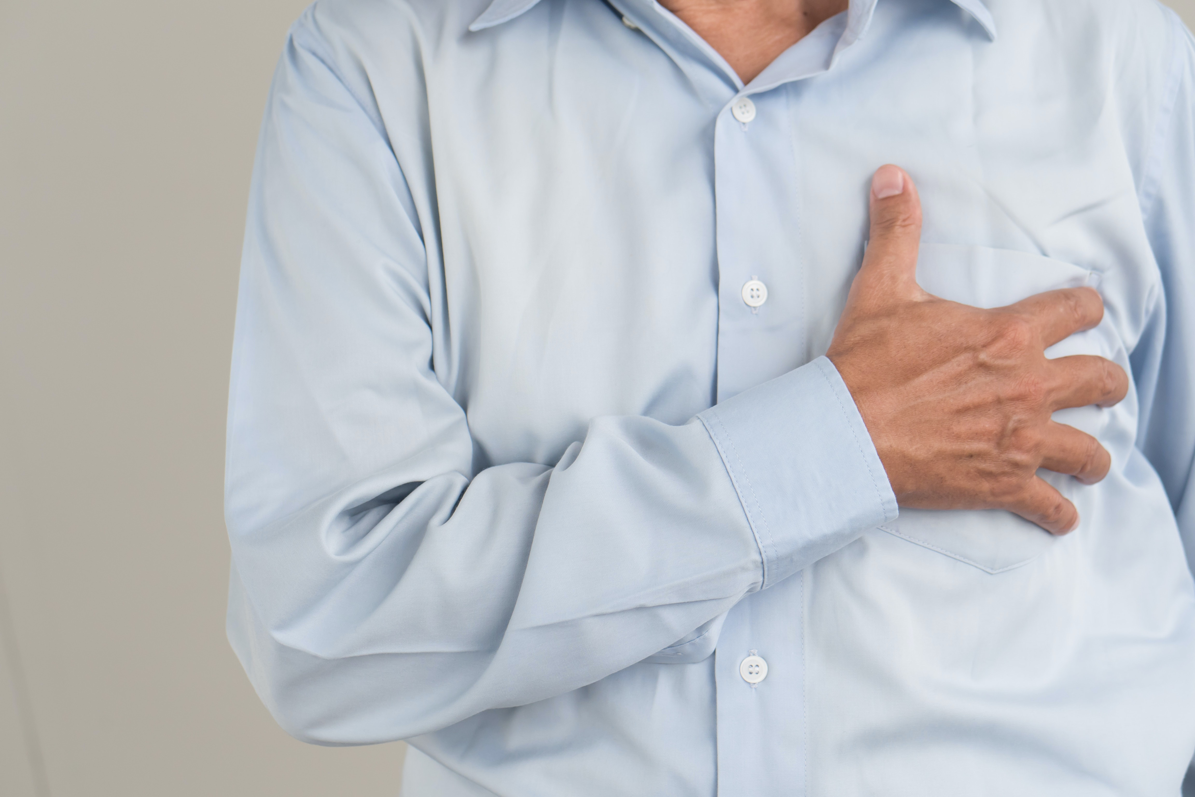 An image depicting a person suffering from mild chest pain symptoms