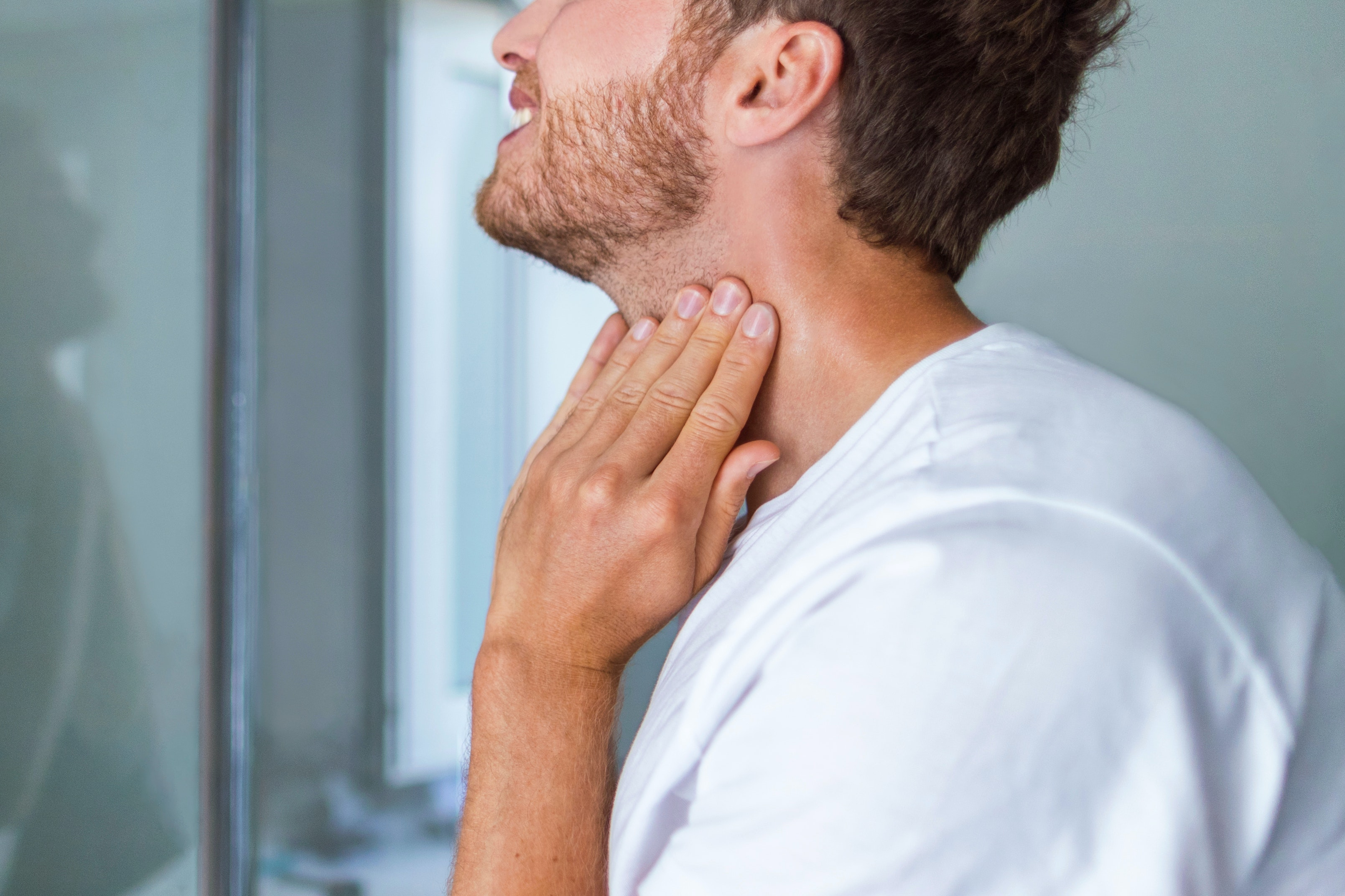 An image depicting a person suffering from mild neck swelling symptoms