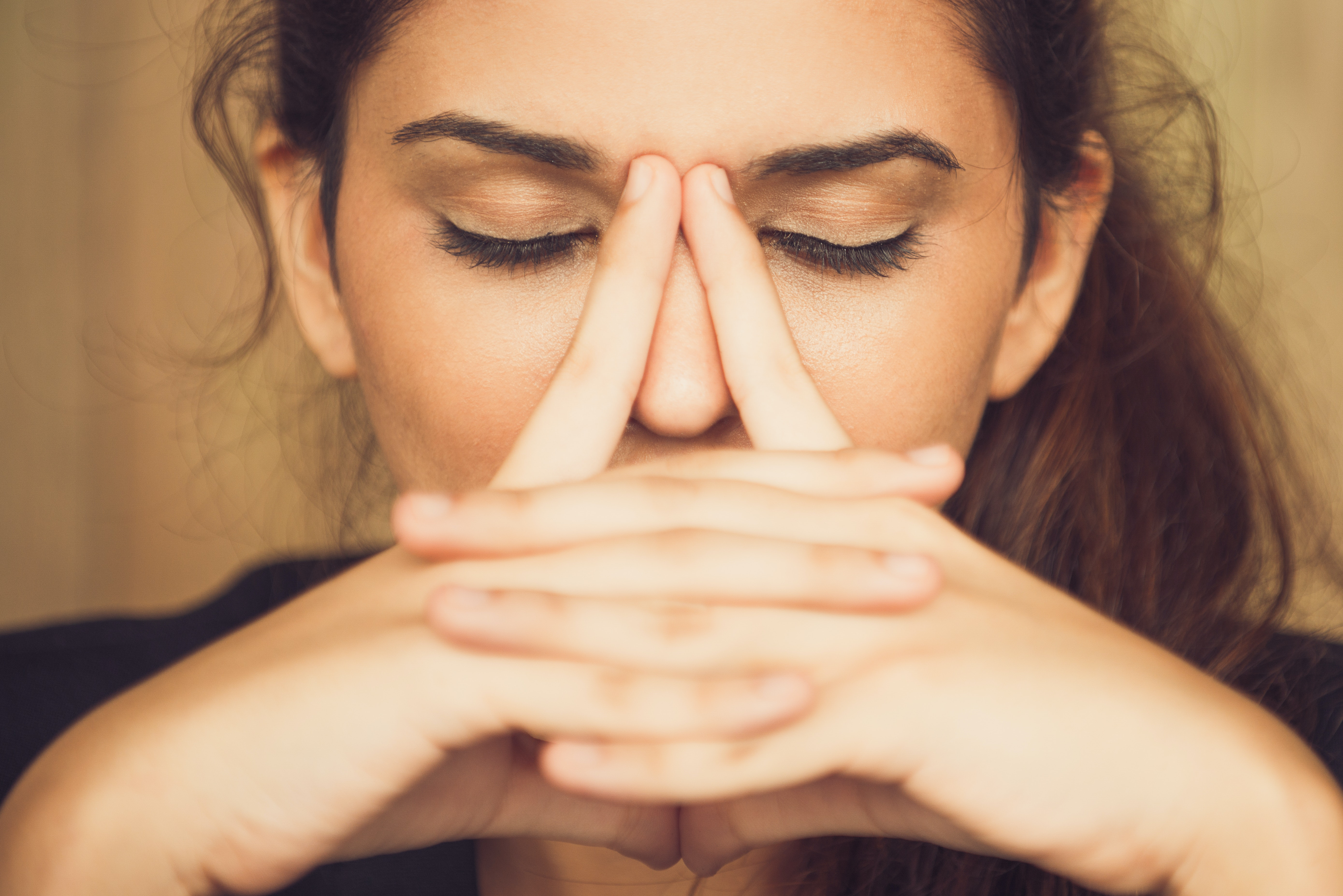 An image depicting a person suffering from mild nose pain symptoms