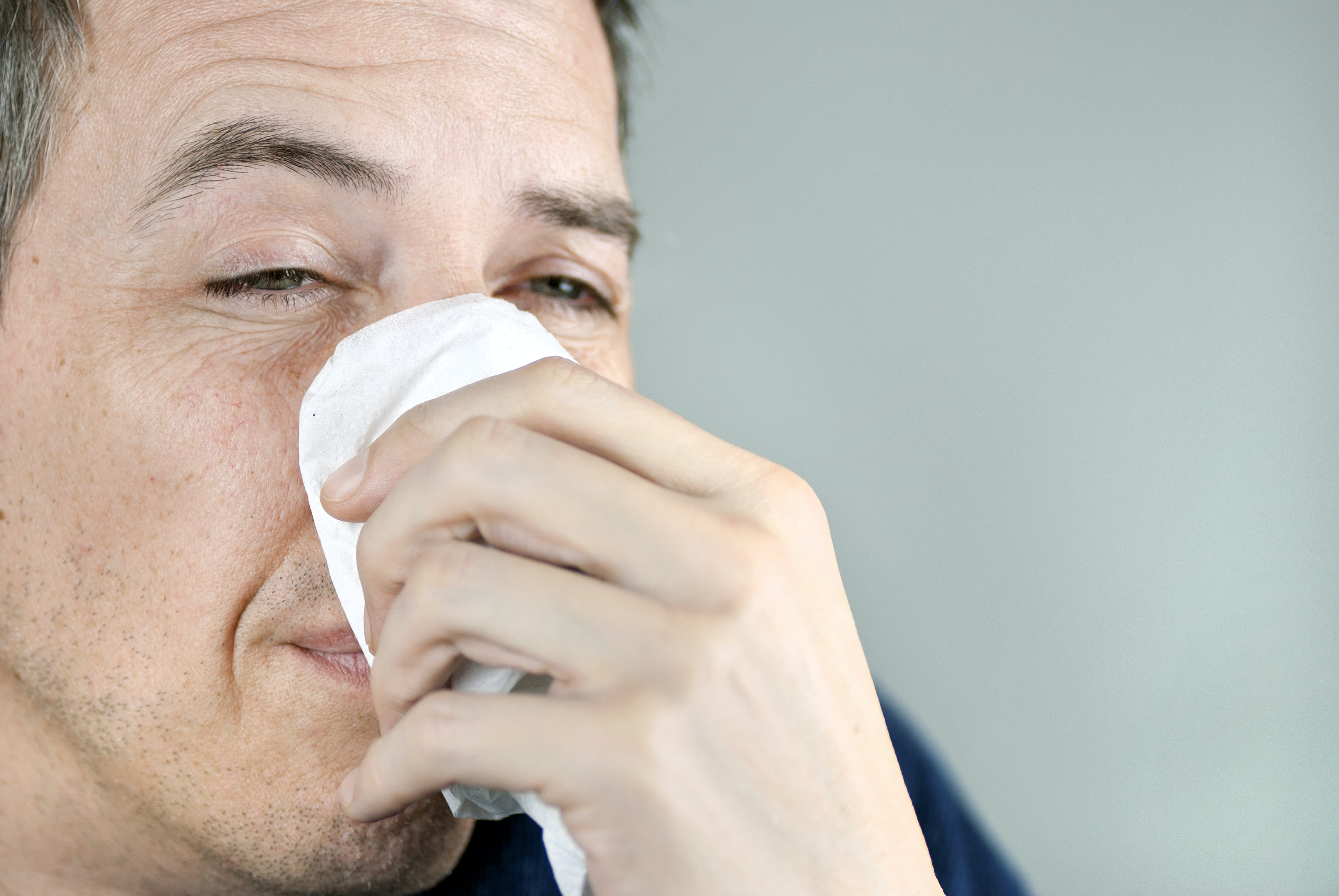 An image depicting a person suffering from nasal ulcer symptoms