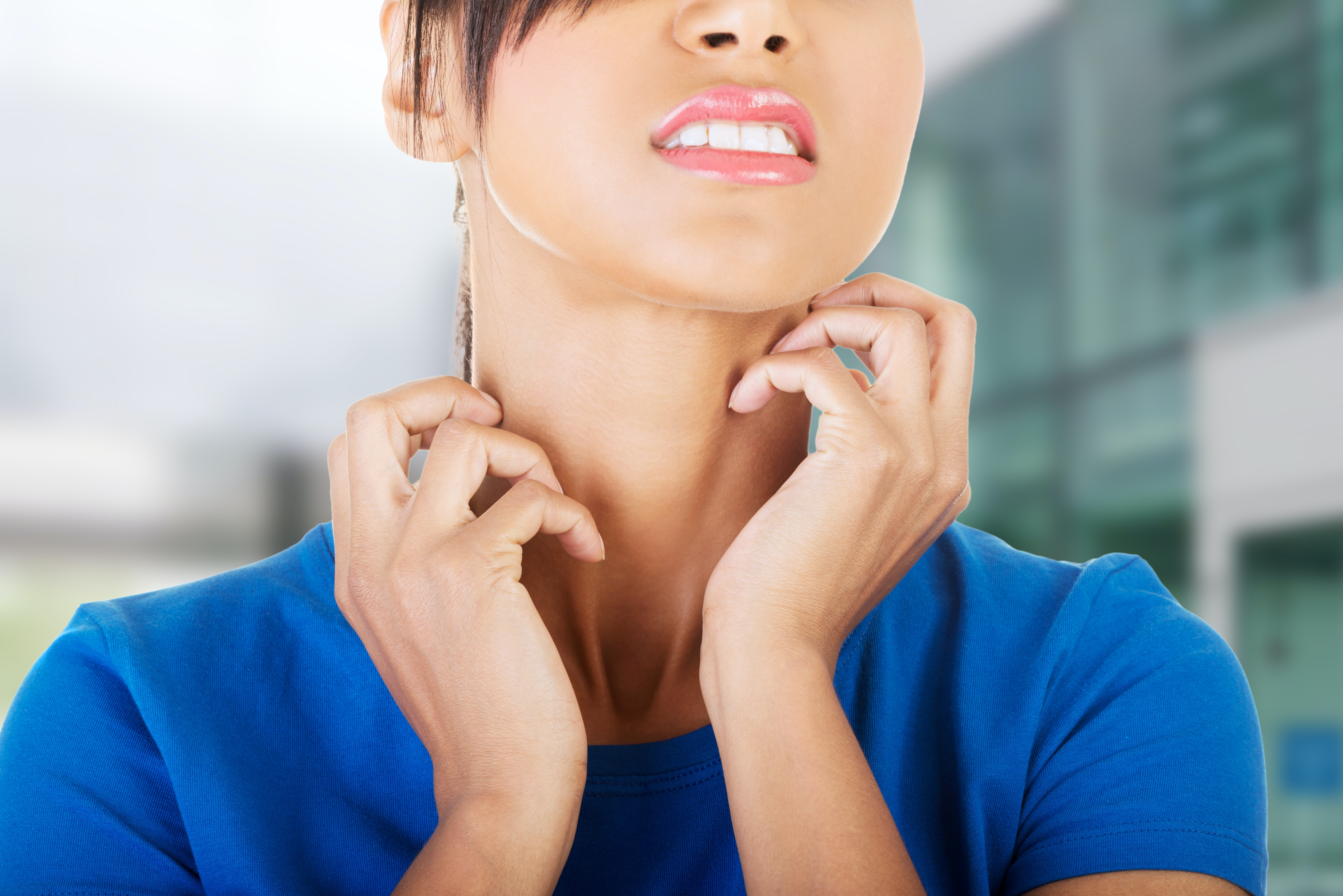An image depicting a person suffering from neck itch symptoms