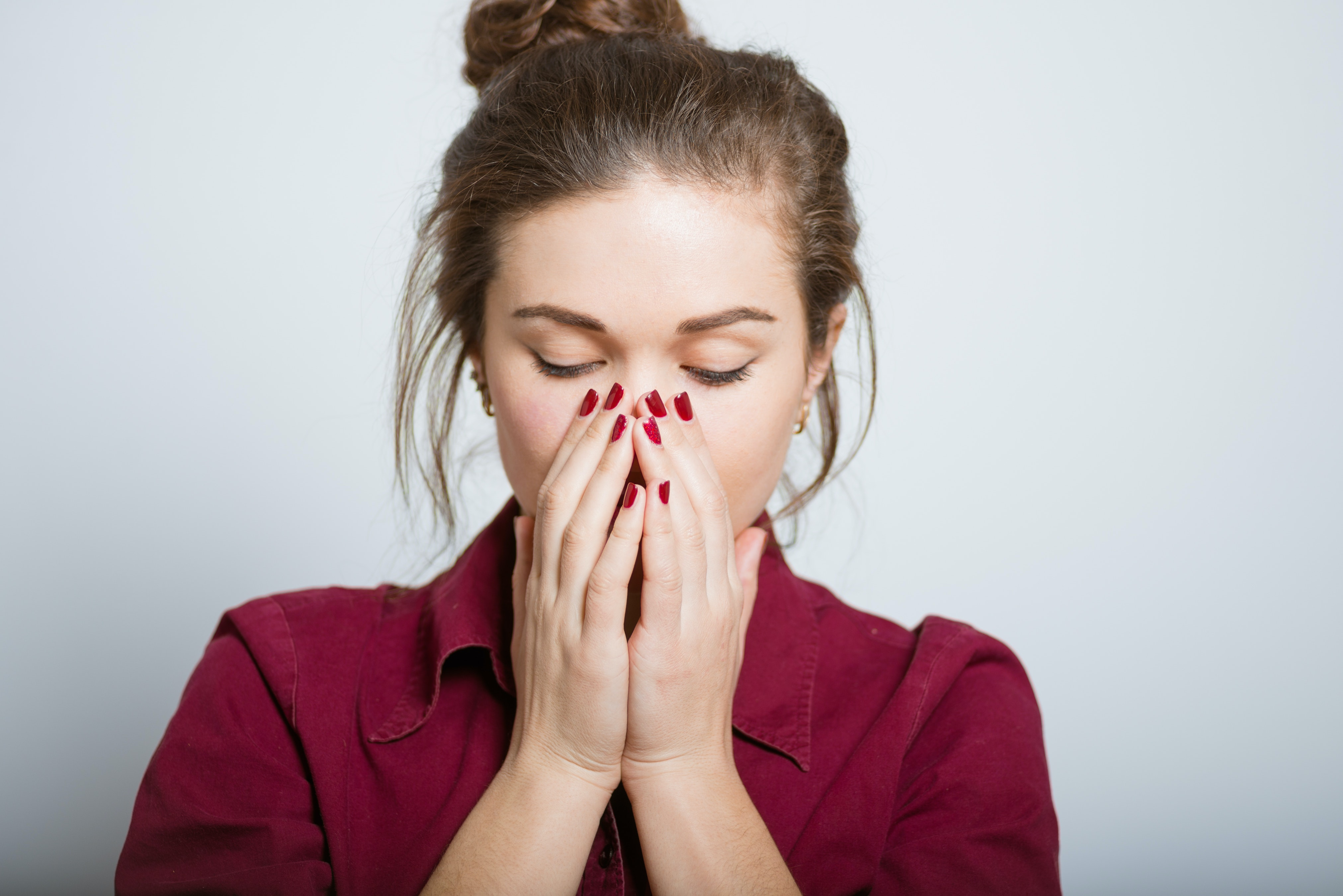 An image depicting a person suffering from nose redness symptoms