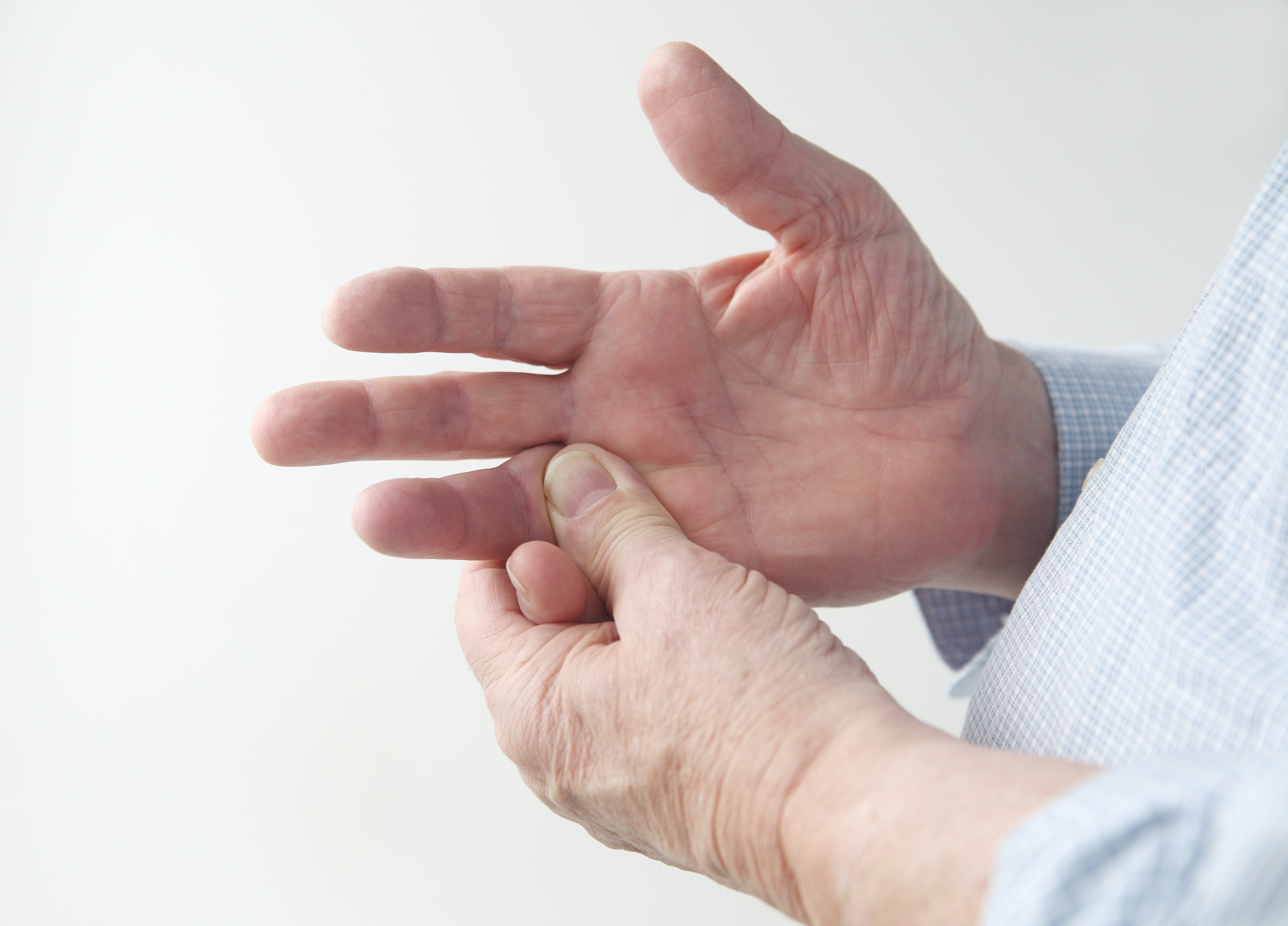An image depicting a person suffering from numbness in both hands symptoms