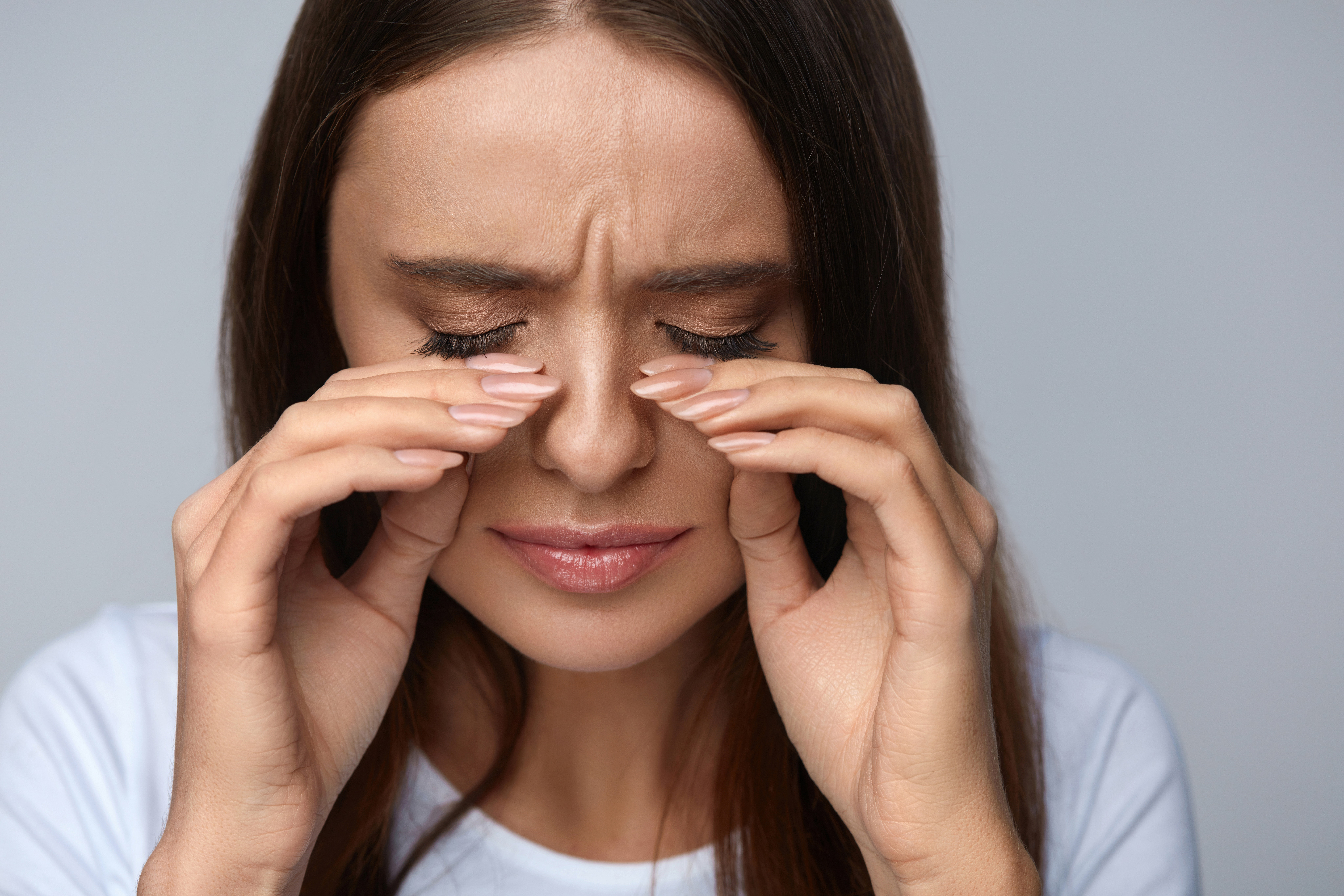 An image depicting a person suffering from Orbital Cellulitis symptoms