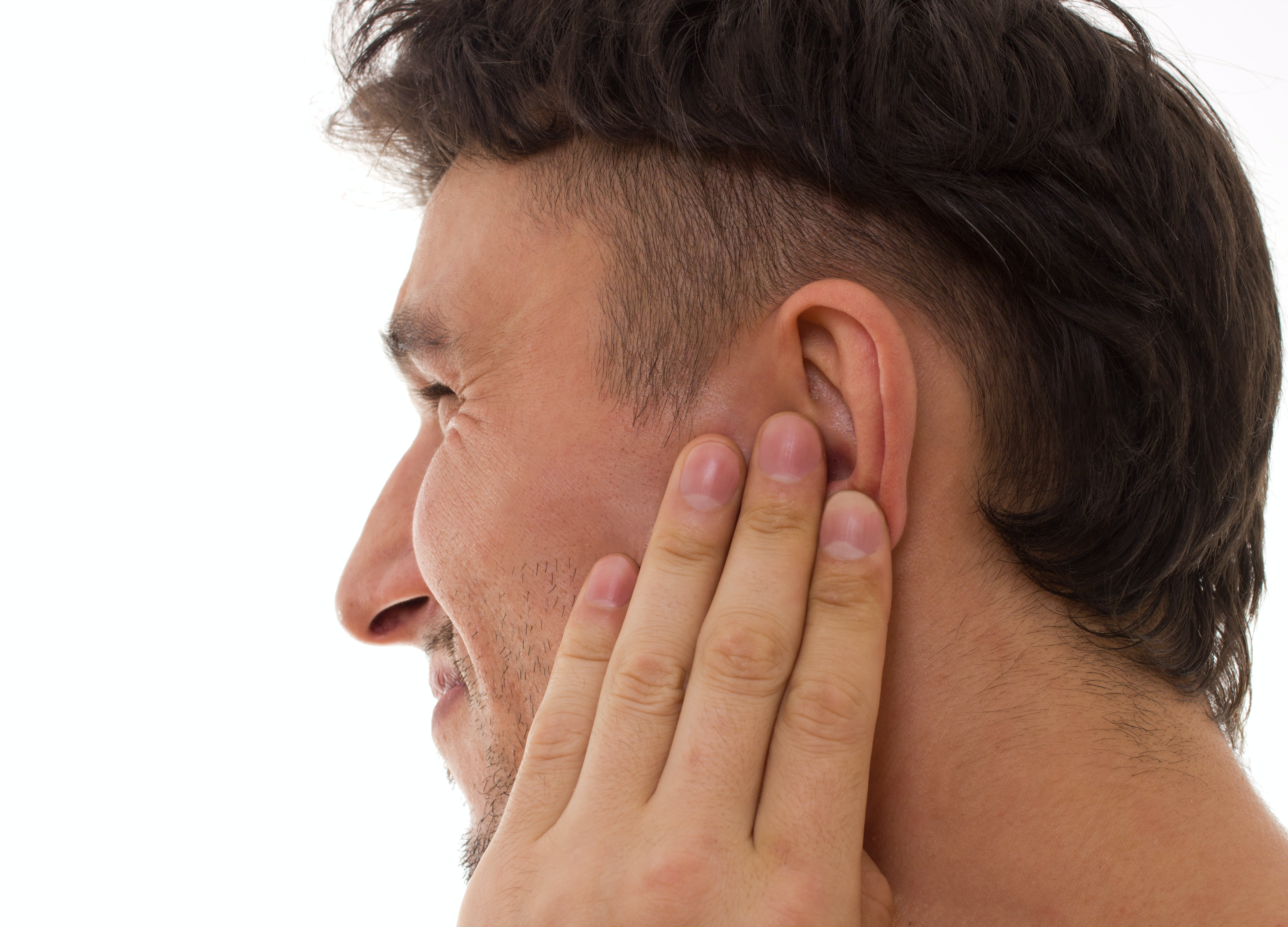 An image depicting a person suffering from outer ear pain symptoms
