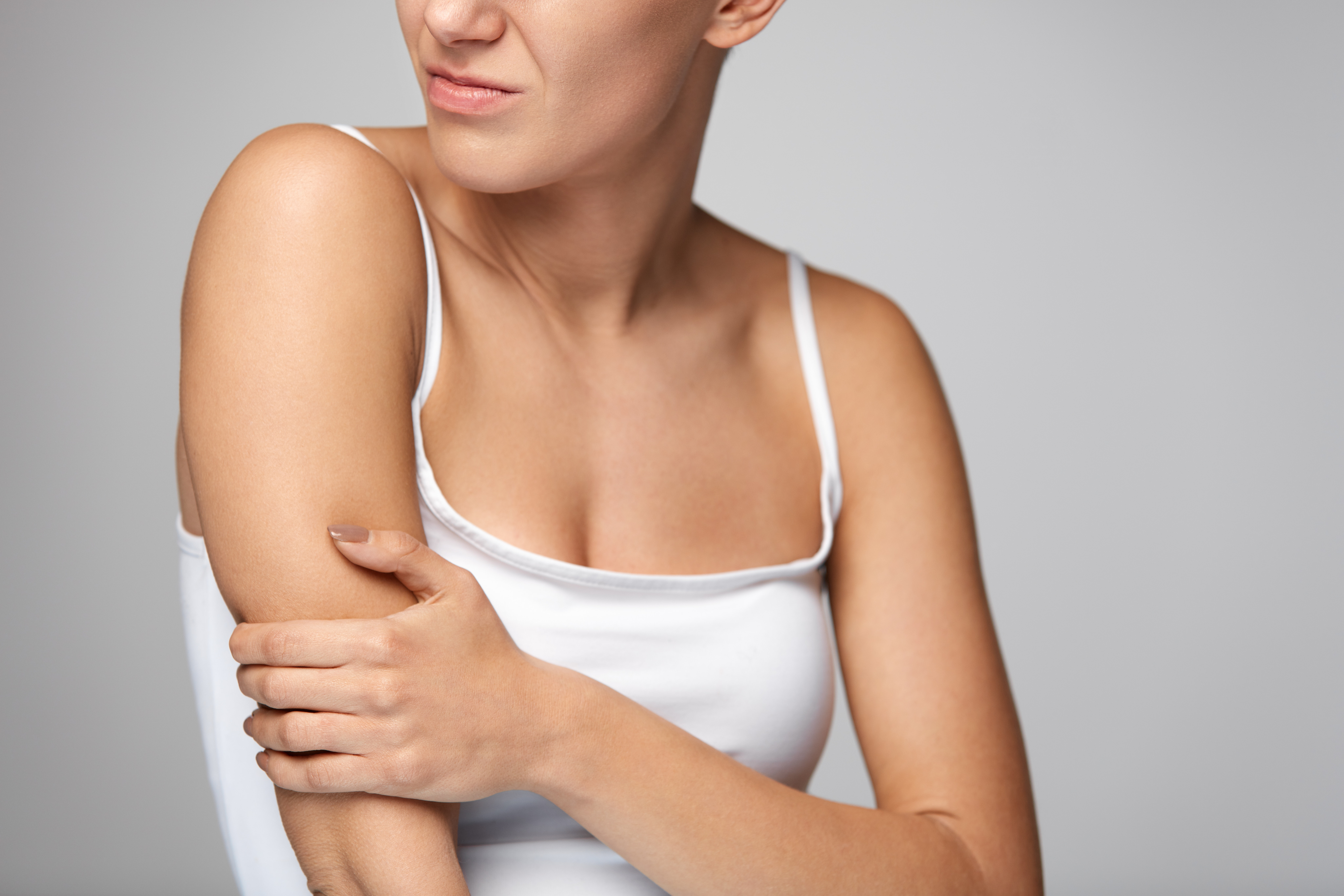 An image depicting a person suffering from pain in both forearms symptoms