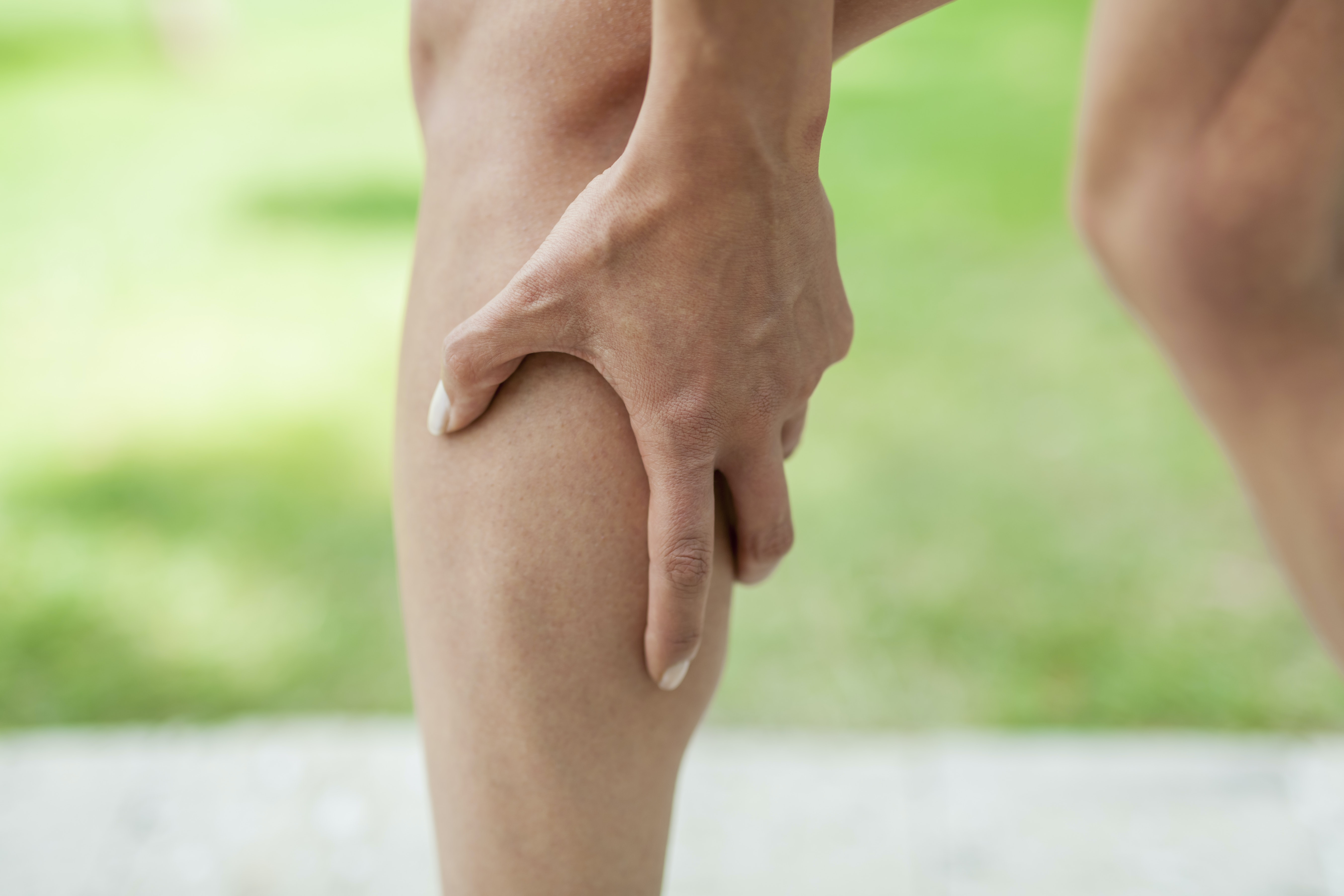 An image depicting a person suffering from pain in one calf symptoms