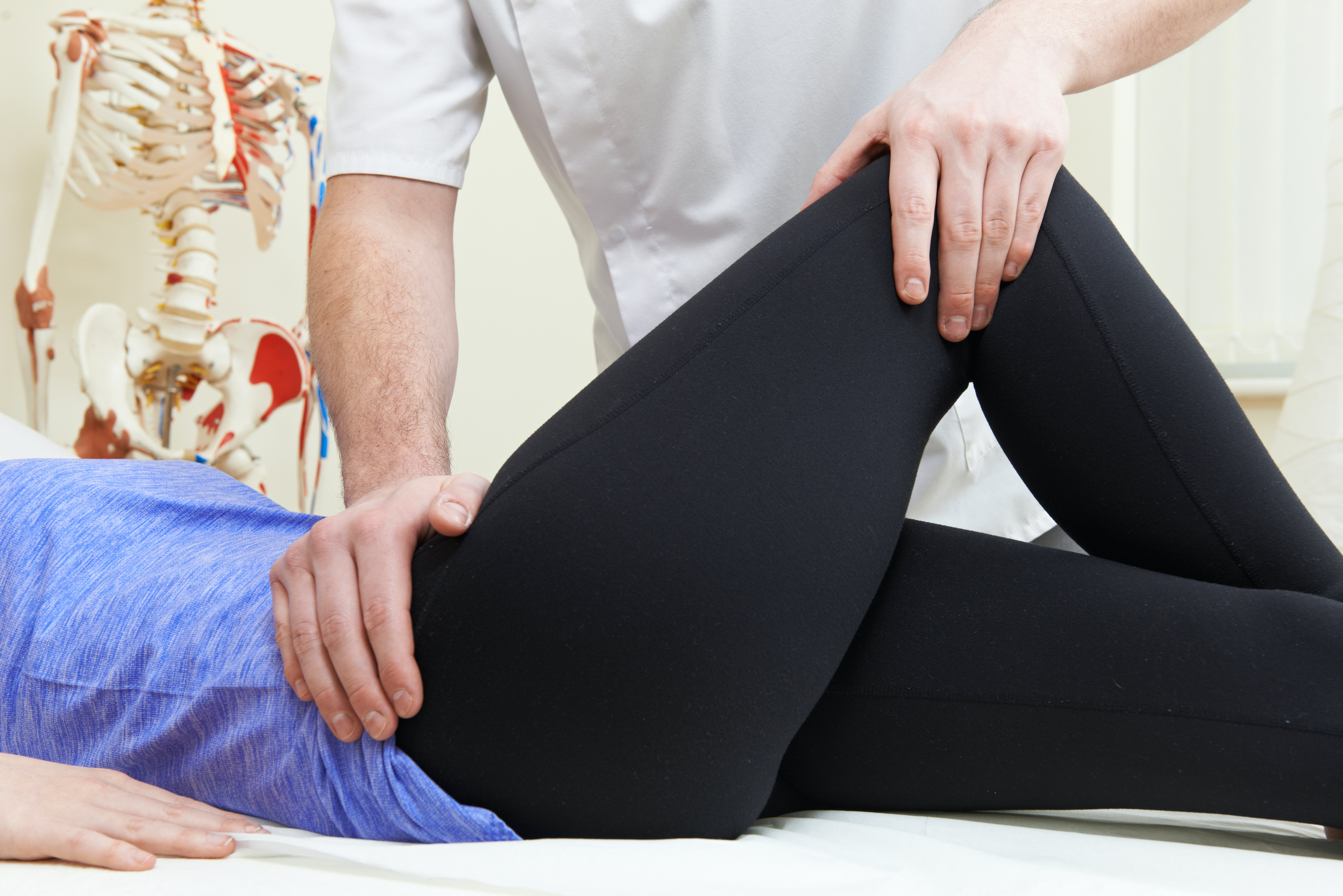 An image depicting a person suffering from pain in one hip symptoms