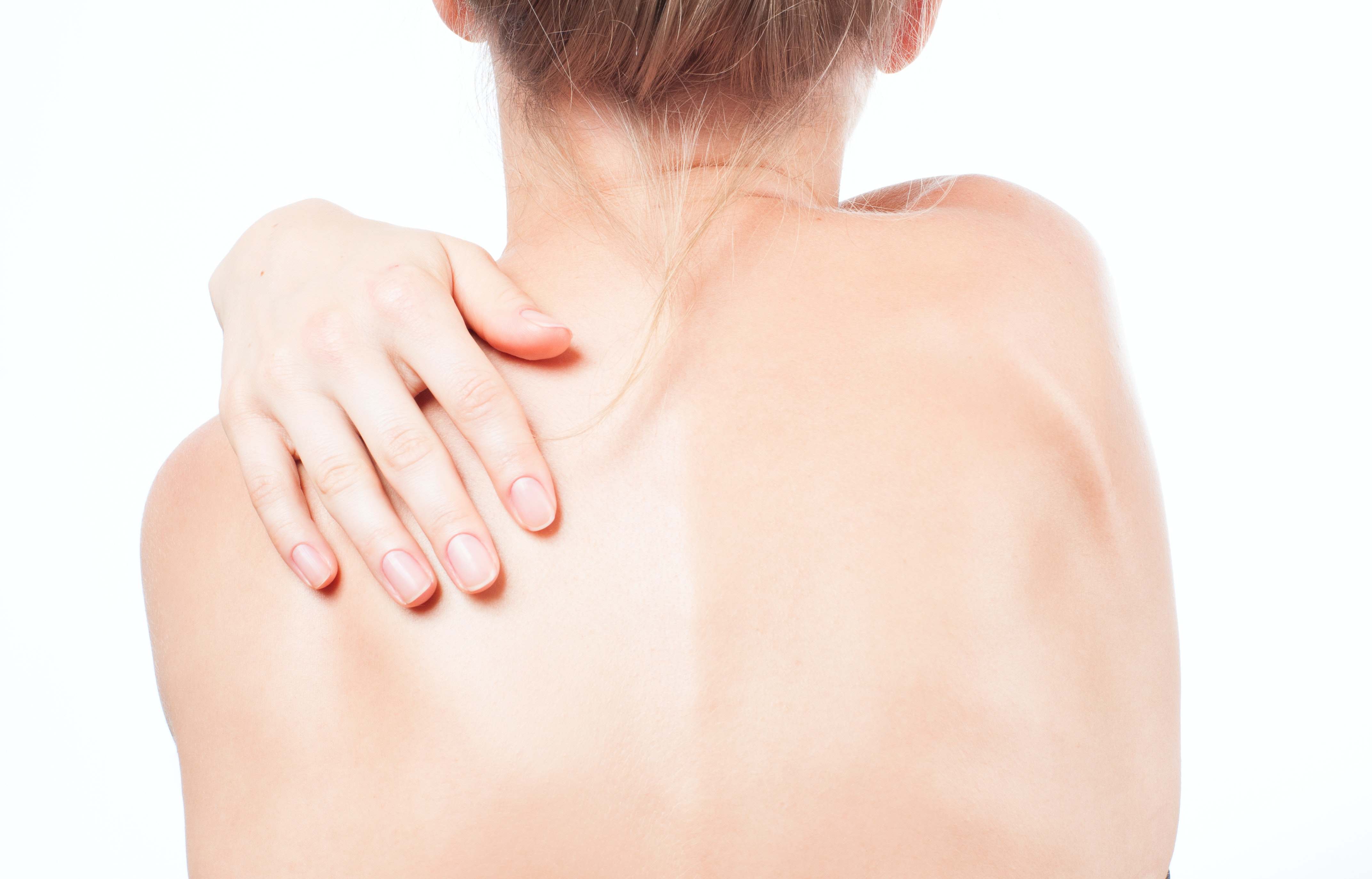 An image depicting a person suffering from pain in one shoulder blade symptoms