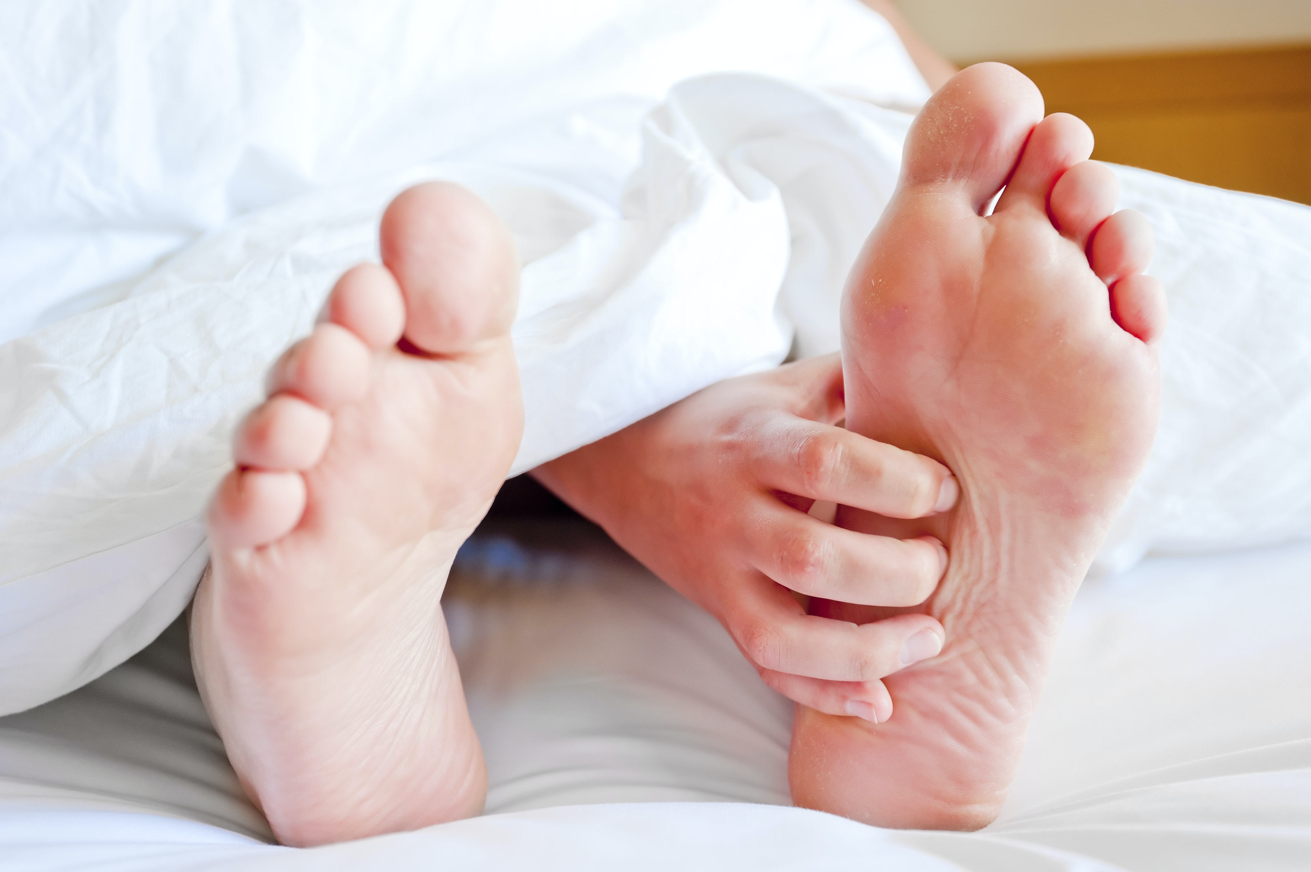 An image depicting a person suffering from pain in the sole of the foot that gets worse in the morning symptoms