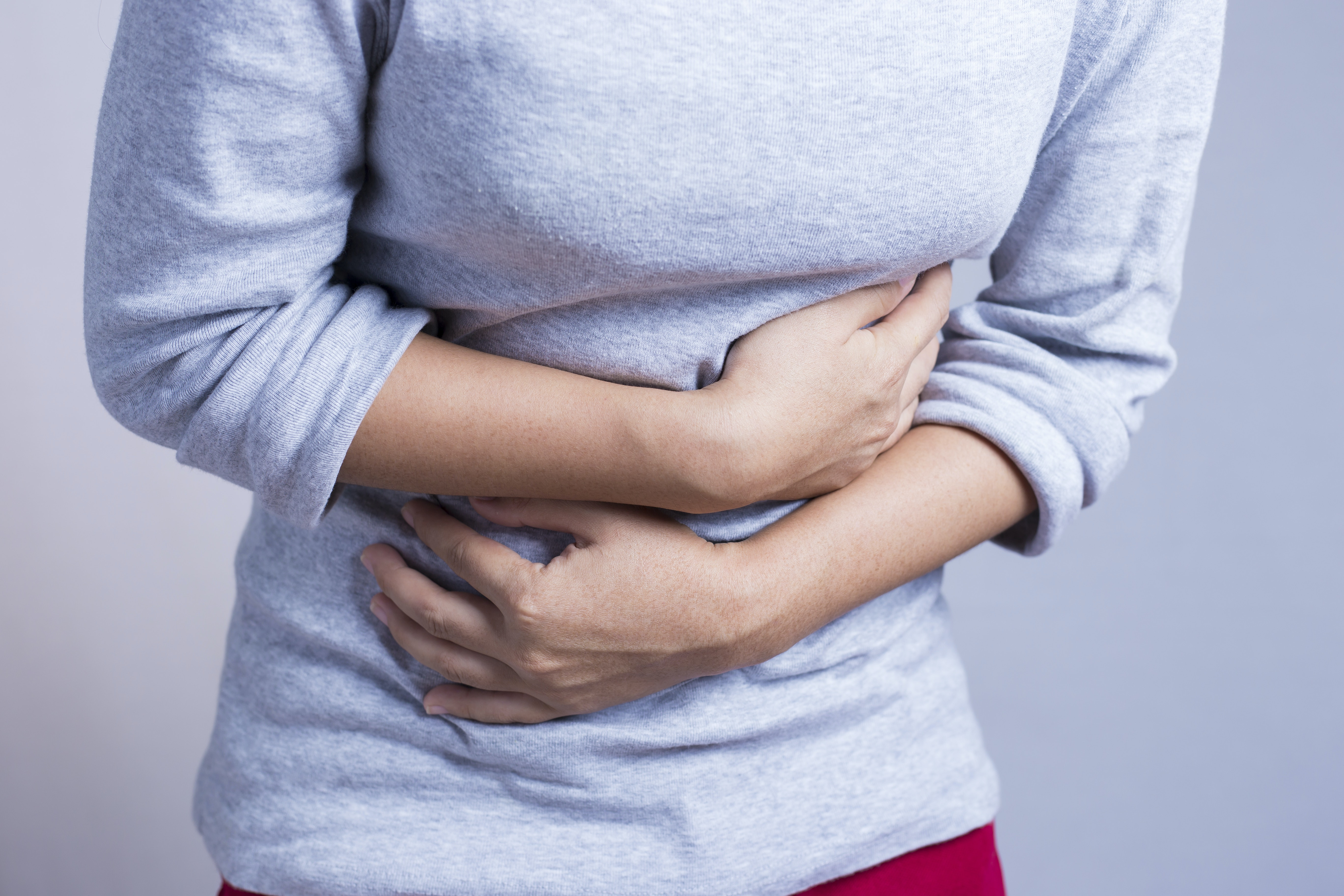 An image depicting a person suffering from pain in the upper left abdomen symptoms
