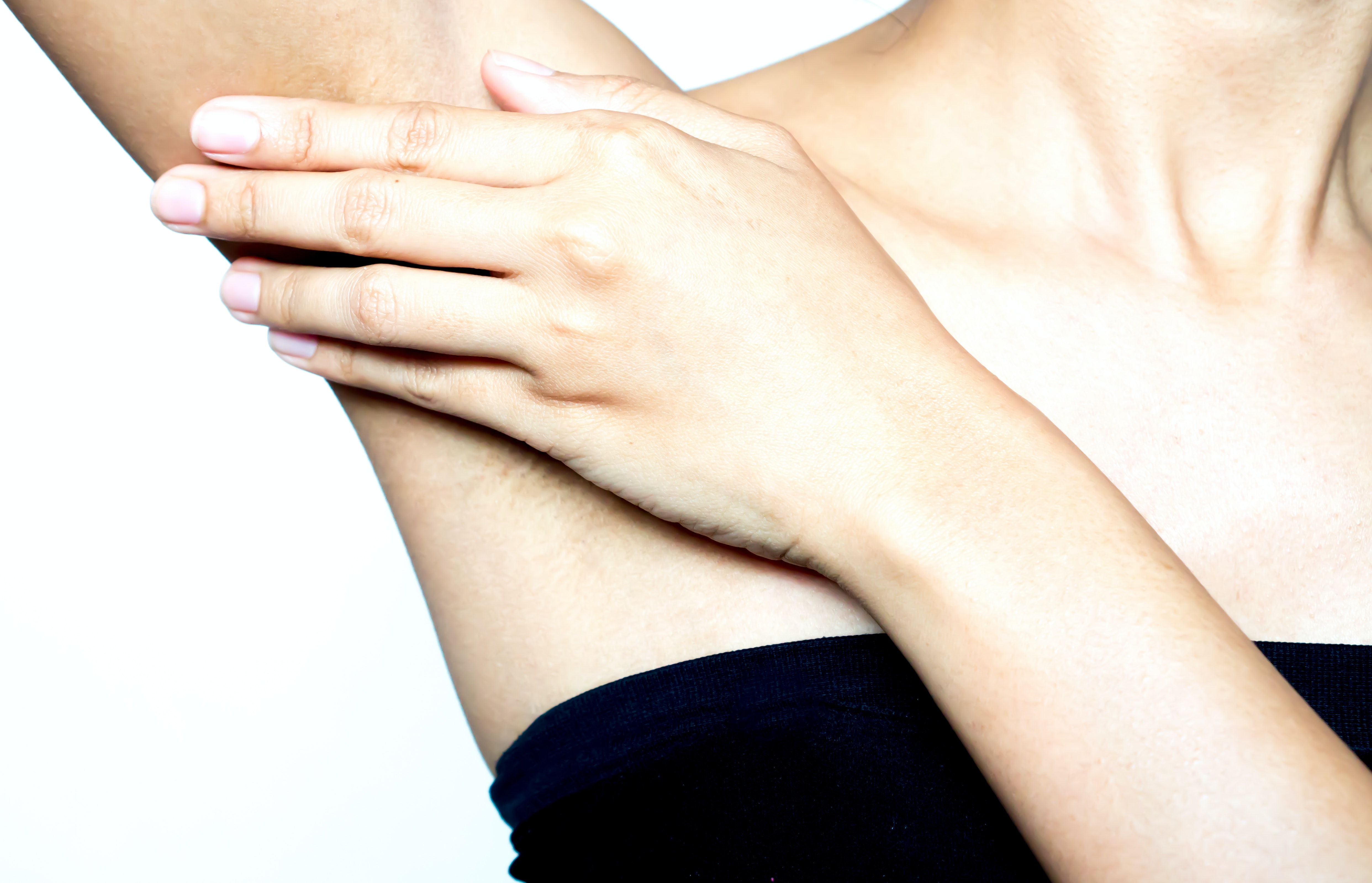 An image depicting a person suffering from painful armpit lump symptoms