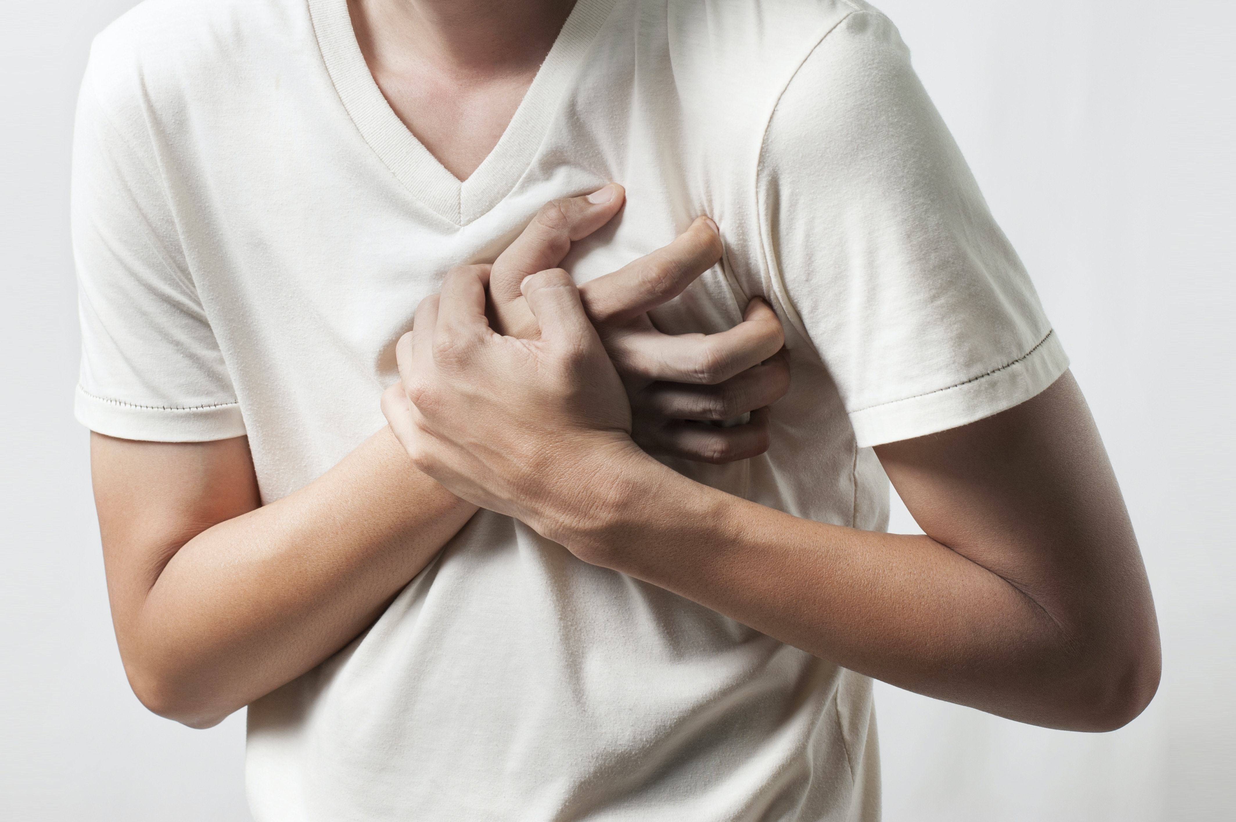 An image depicting a person suffering from painful chest wall lump symptoms