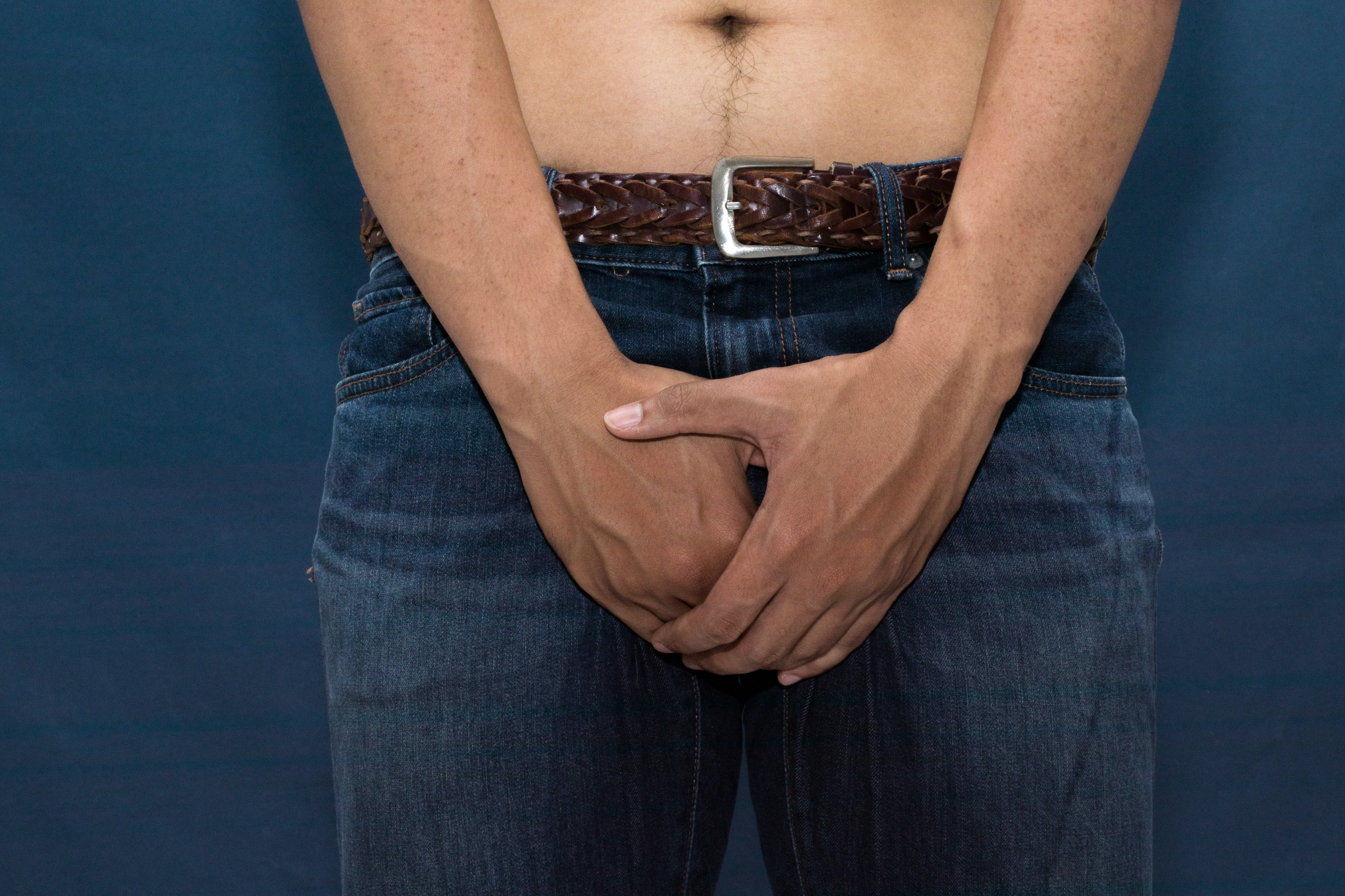 An image depicting a person suffering from painful testicle lump symptoms