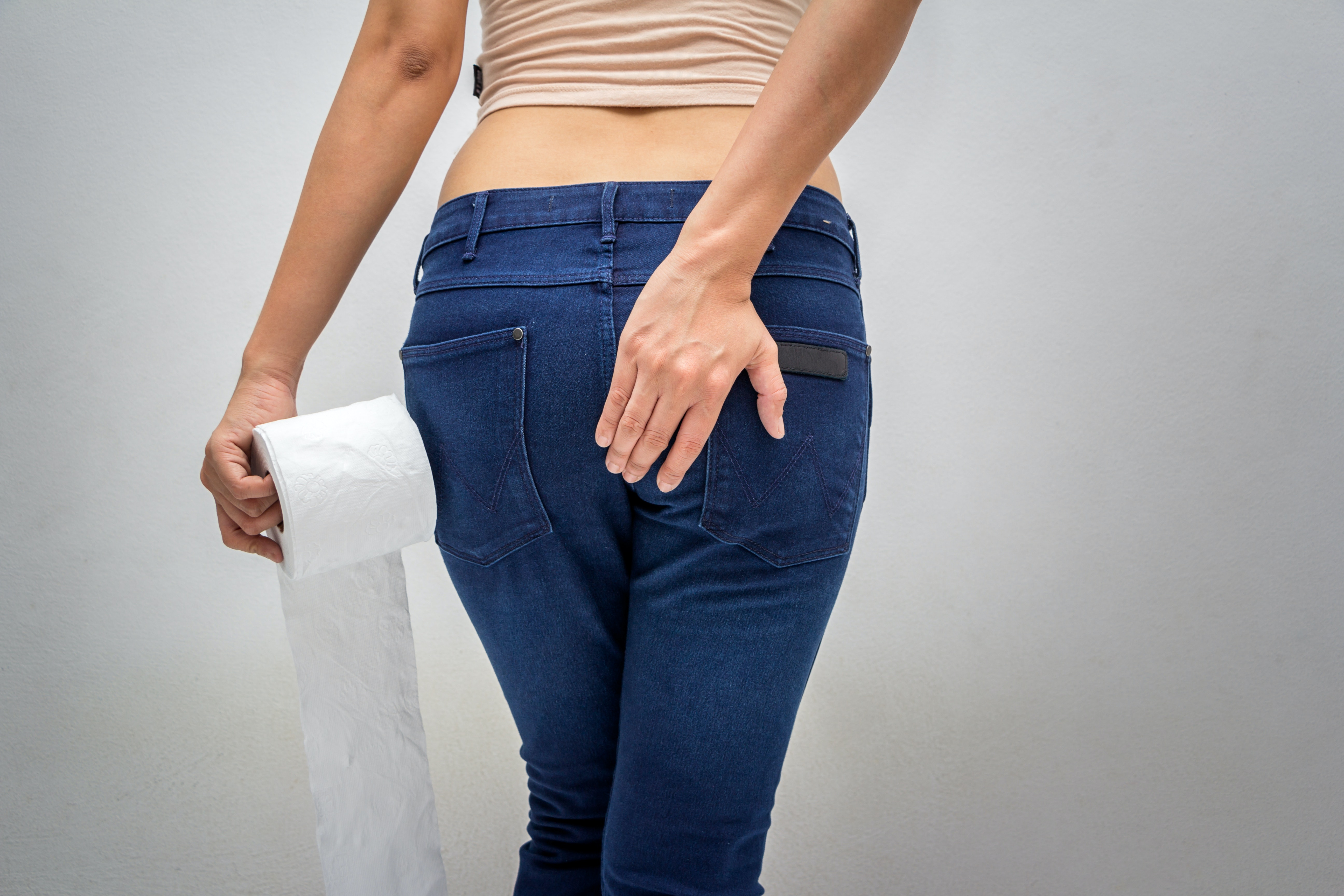 An image depicting a person suffering from painless rectal bleeding symptoms