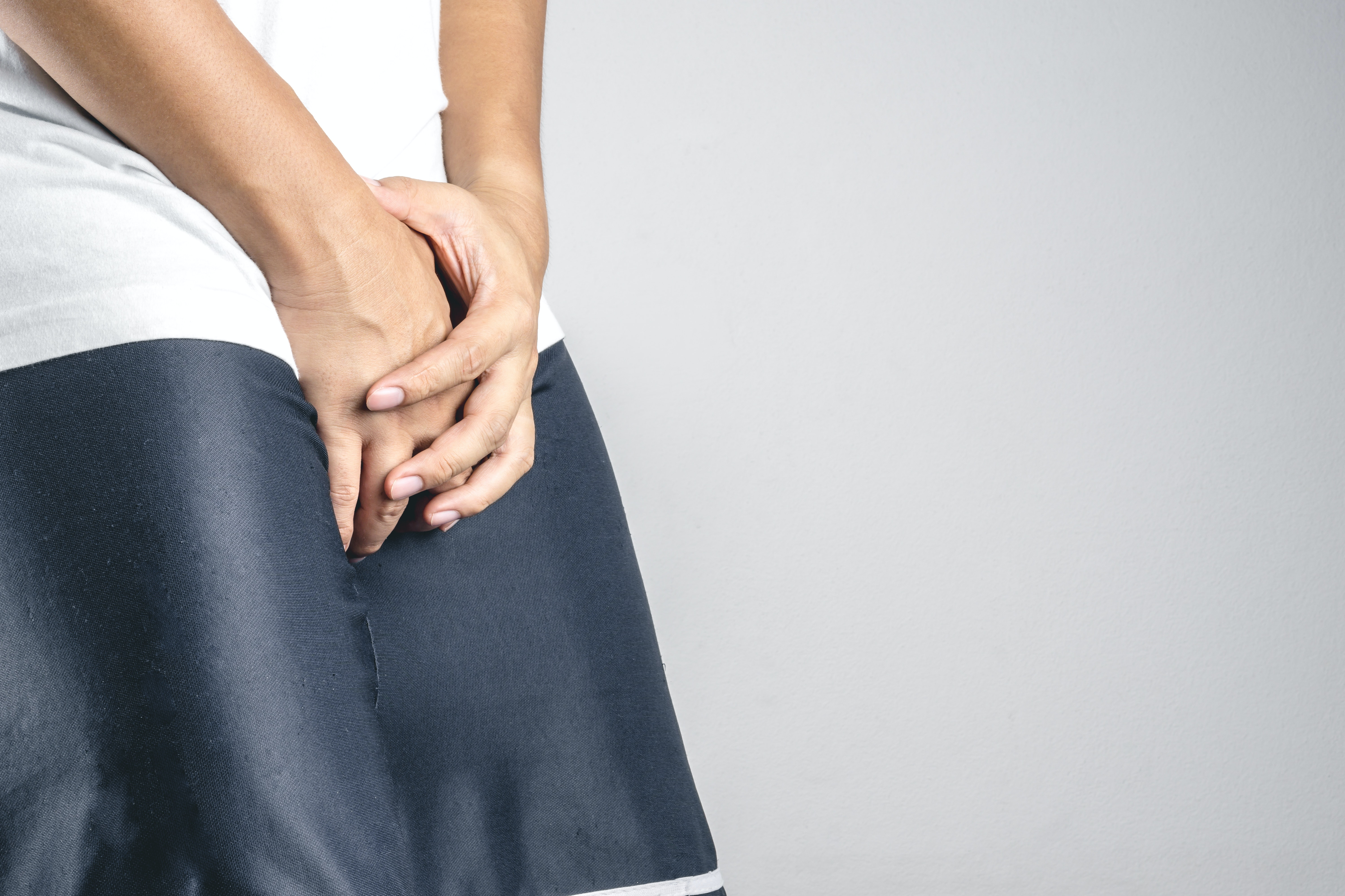 An image depicting a person suffering from penis pain symptoms