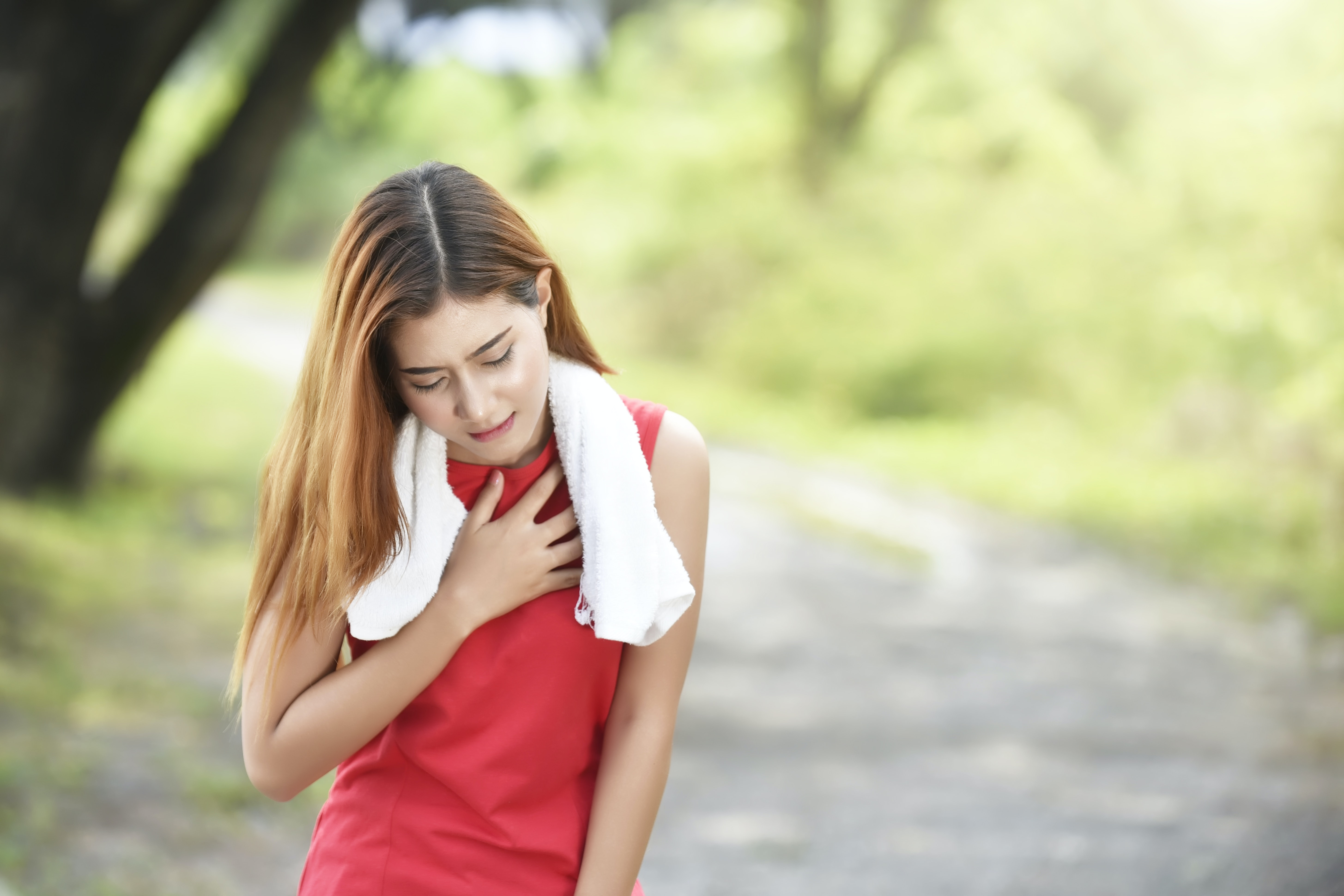 An image depicting a person suffering from racing heart beat symptoms