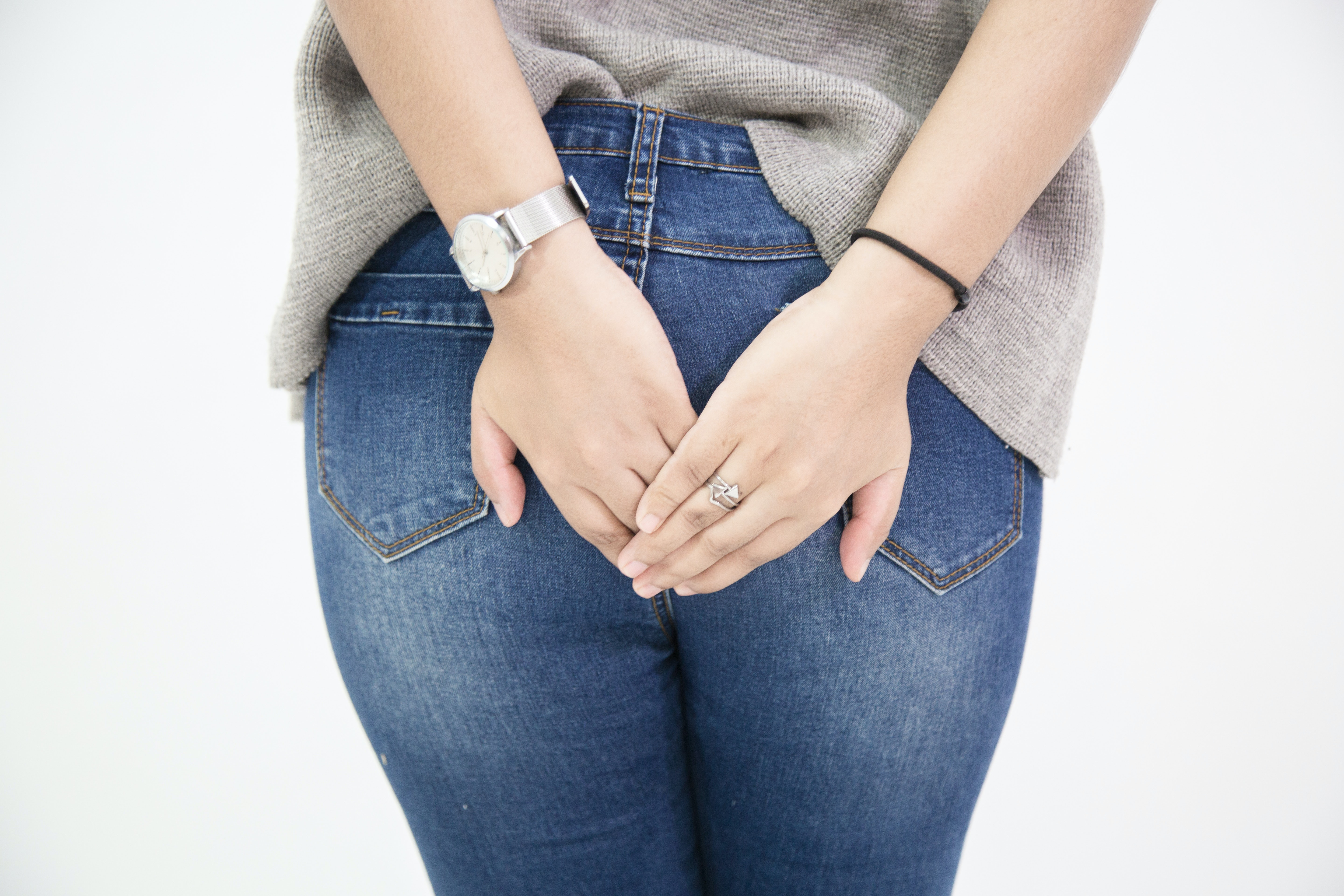 An image depicting a person suffering from rectal pain symptoms