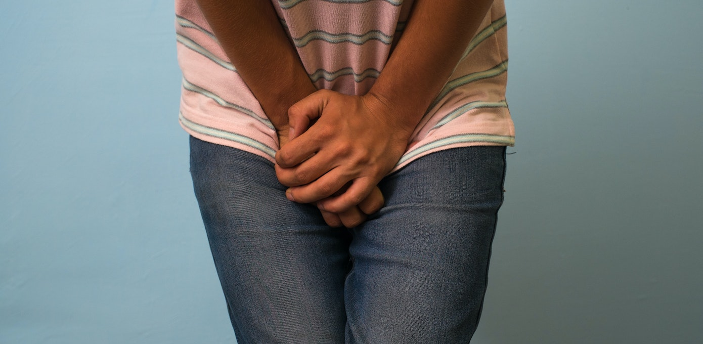 An image depicting a person suffering from redness at the tip of the penis  symptoms
