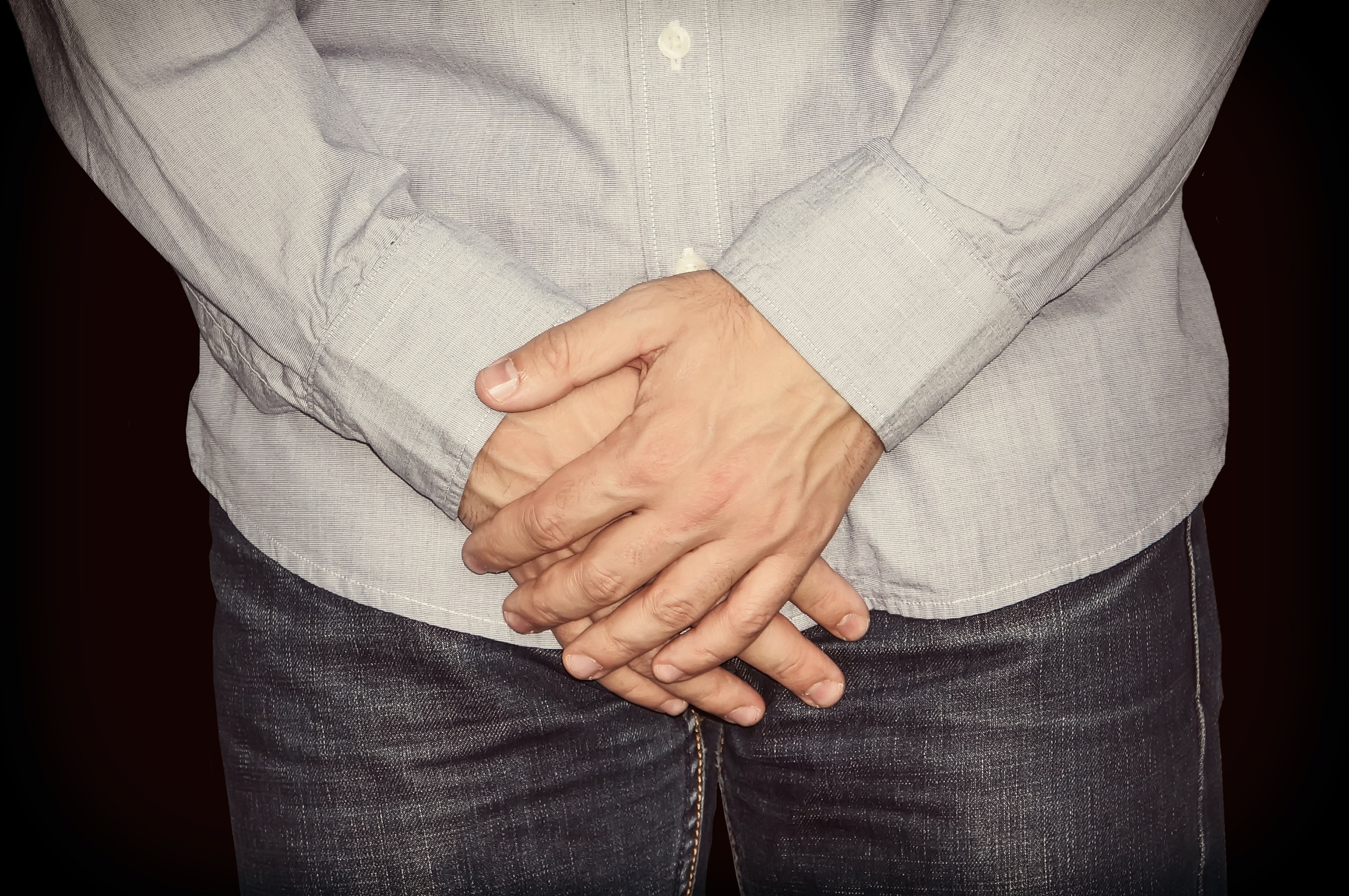 An image depicting a person suffering from scrotal rash symptoms