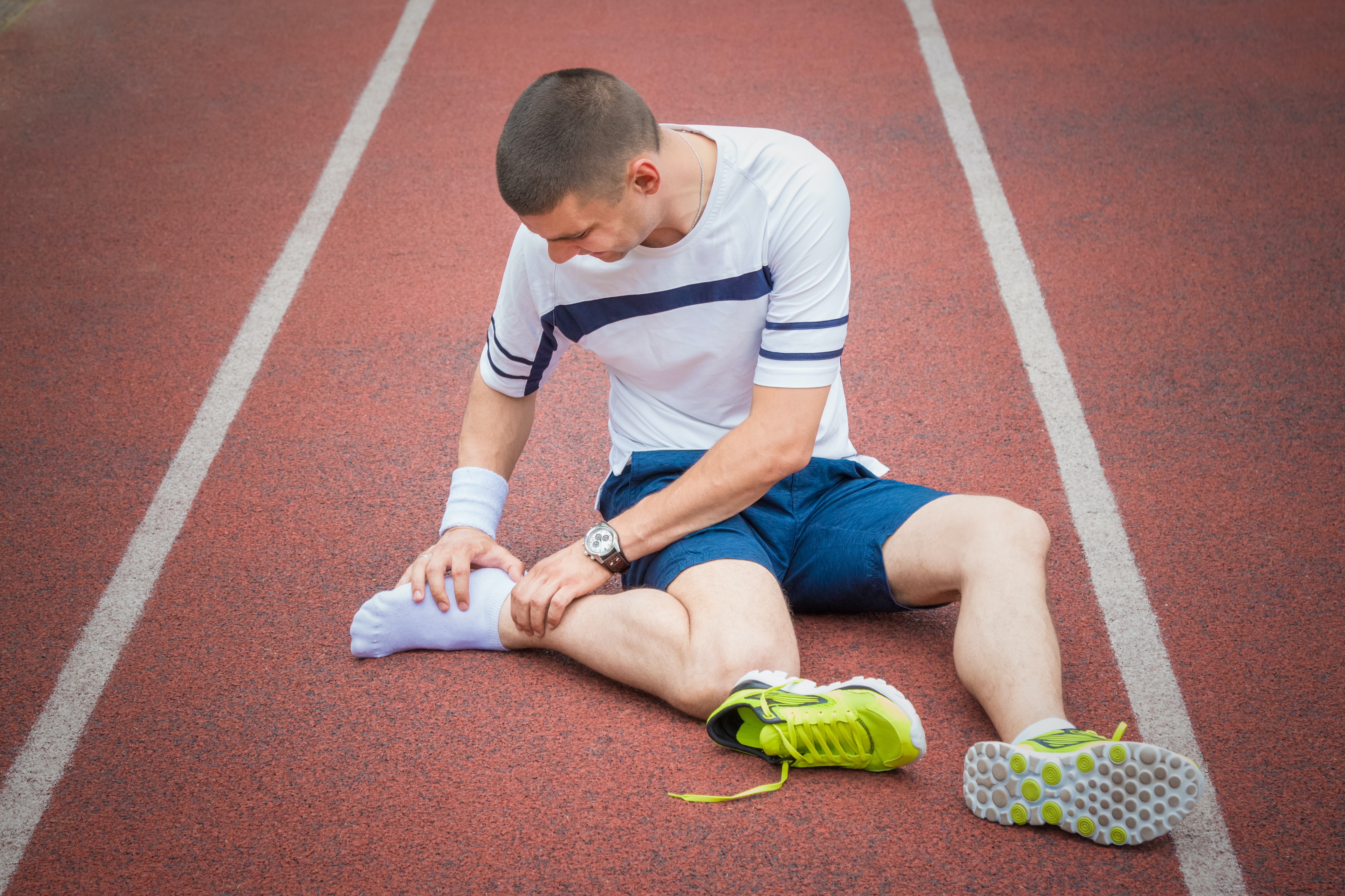 An image depicting a person suffering from severe ankle pain symptoms