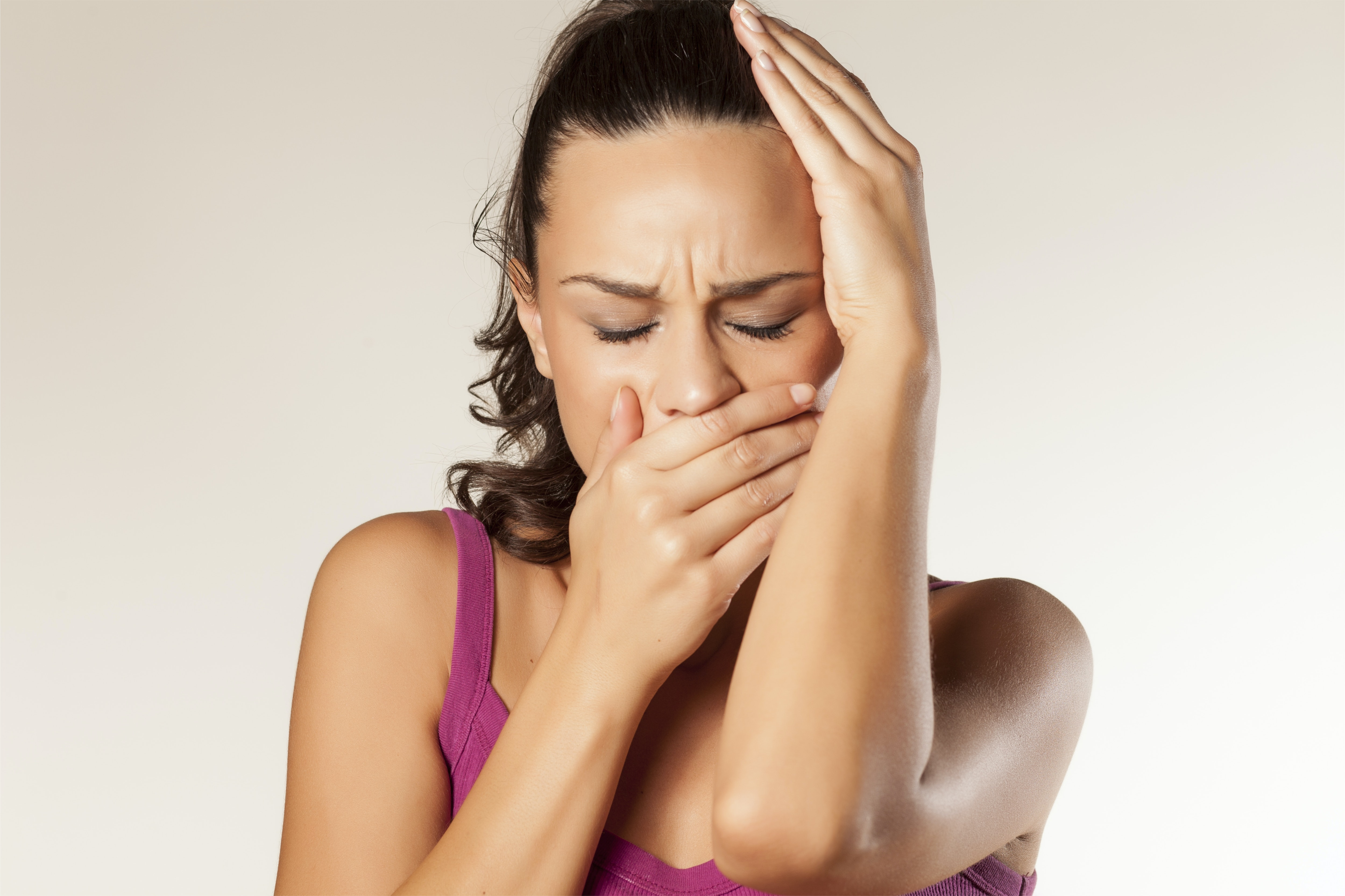 An image depicting a person suffering from severe jaw pain symptoms