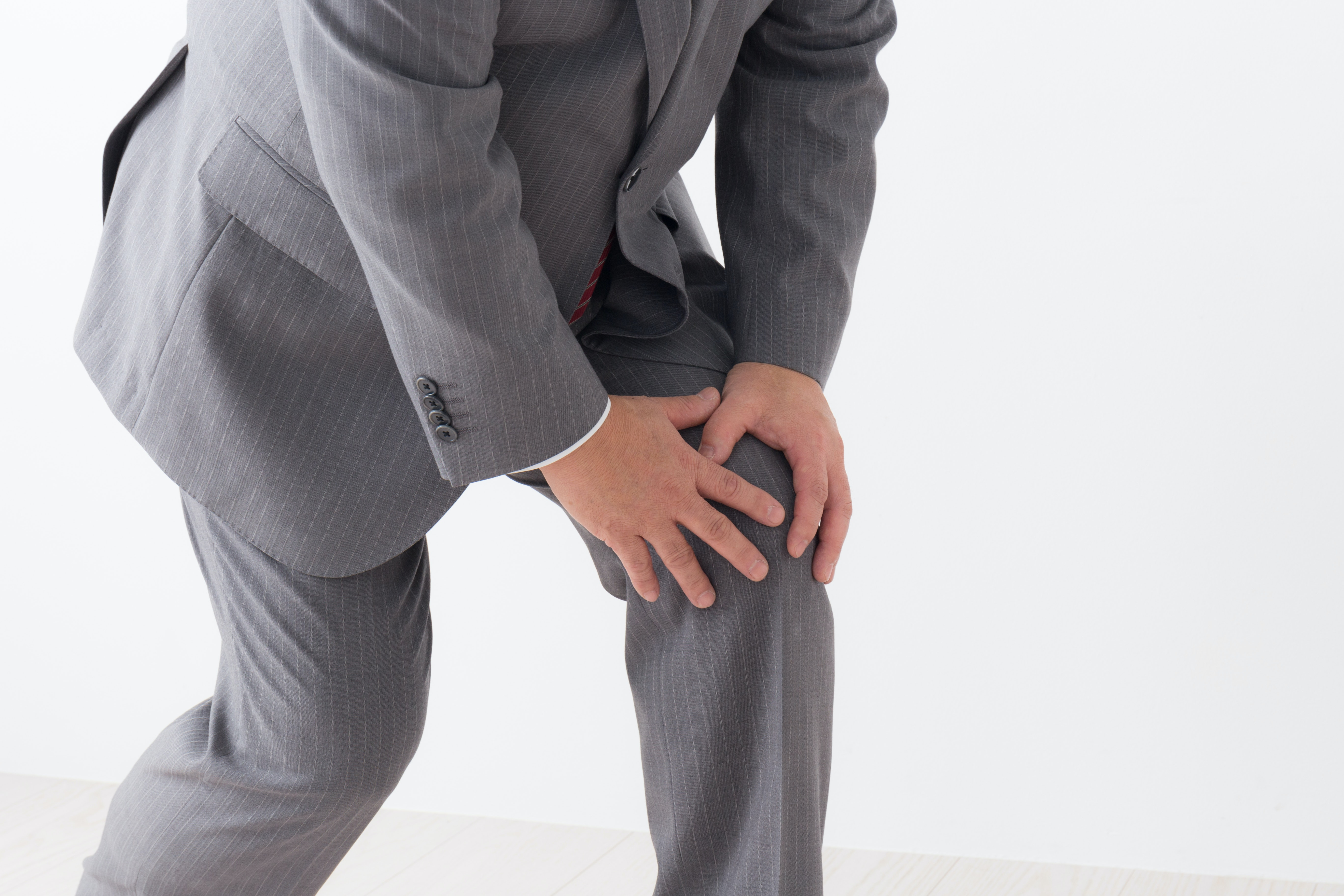 An image depicting a person suffering from severe knee pain symptoms