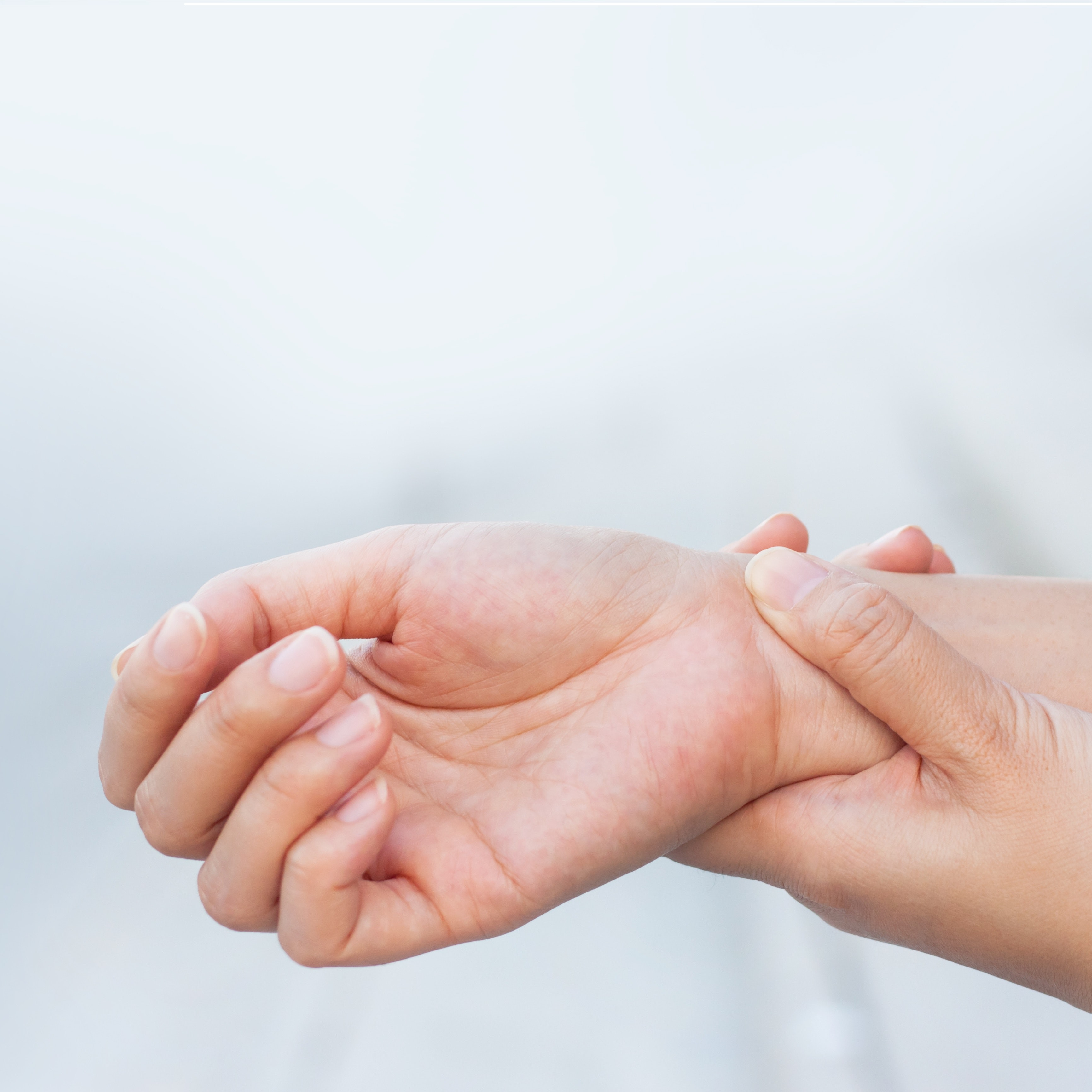 An image depicting a person suffering from severe wrist pain symptoms